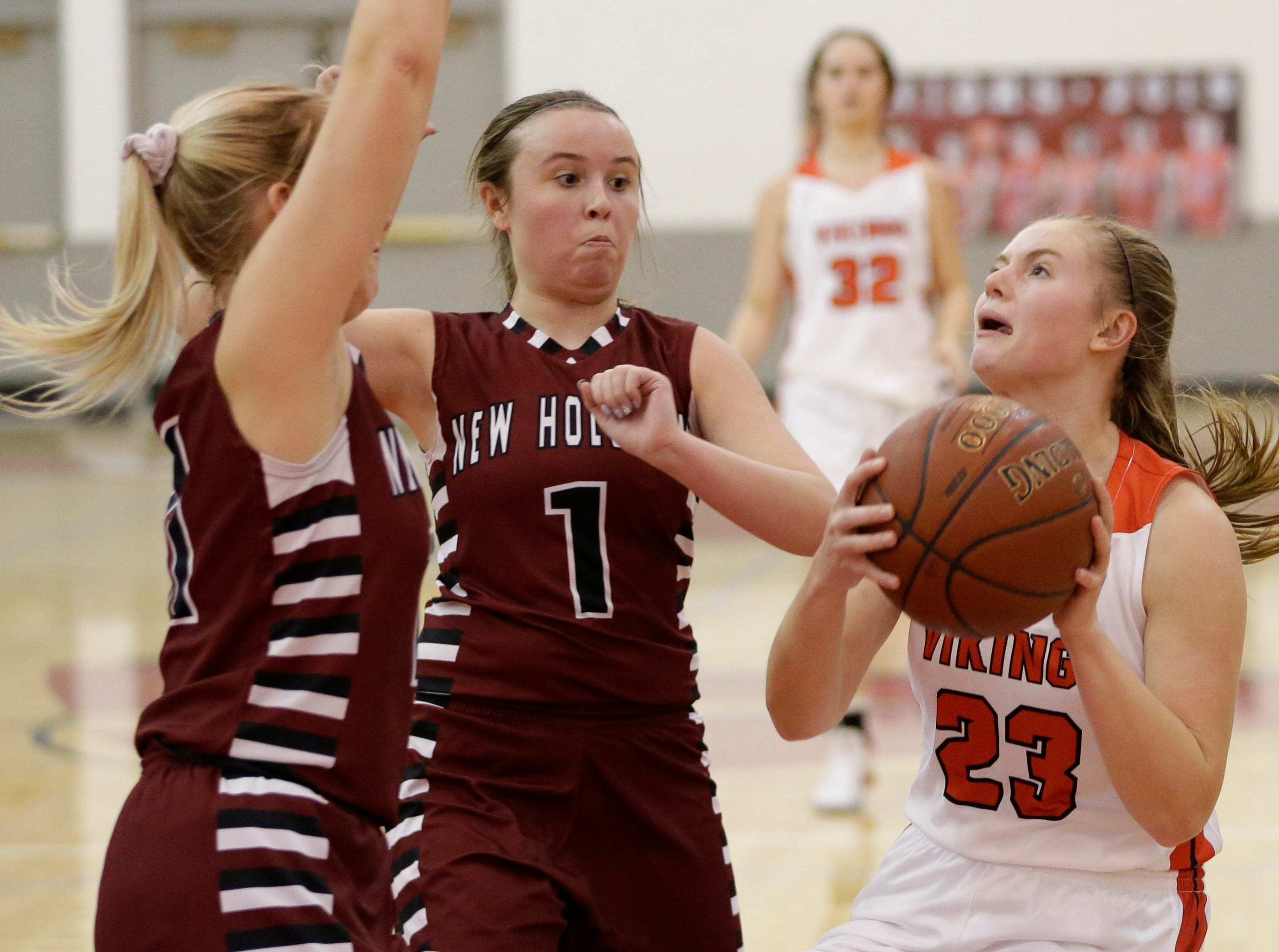 Valders' Madison Sabel (23) goes for a layup against New Holstein at Valders High School Friday, February 8, 2019, in Valders, Wis. Joshua Clark/USA TODAY NETWORK-Wisconsin
