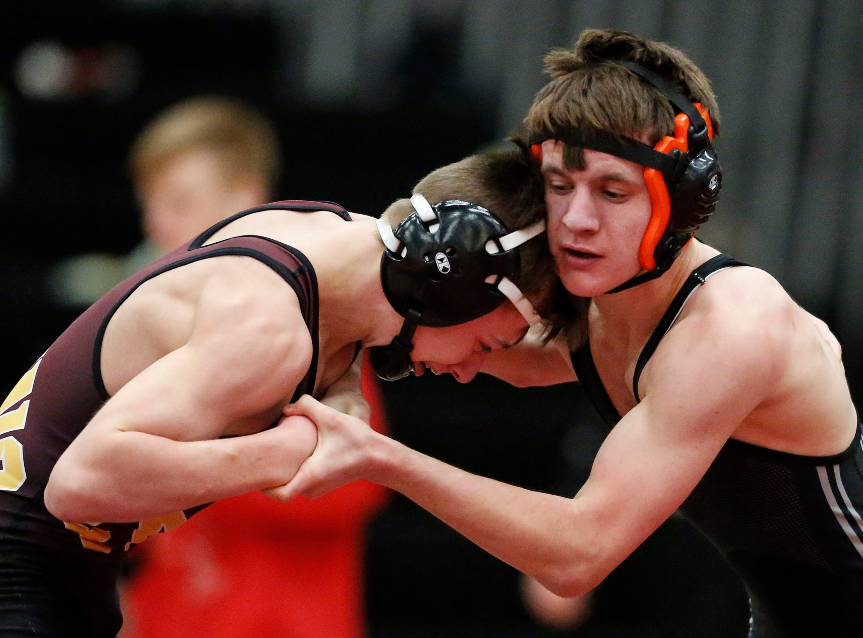 Plymouth's Jack Miller wrestles West Bend East's Cael Pionkowski in the 106 weight class during the WIAA D1 Regionals at Manitowoc Lincoln High School Saturday, February 9, 2019, in Manitowoc, Wis. Joshua Clark/USA TODAY NETWORK-Wisconsin
