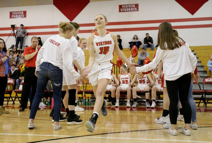 Valders' Jenna Evenson (15) runs out during intorductions before a matchup against New Holstein at Valders High School Friday, February 8, 2019, in Valders, Wis. Joshua Clark/USA TODAY NETWORK-Wisconsin