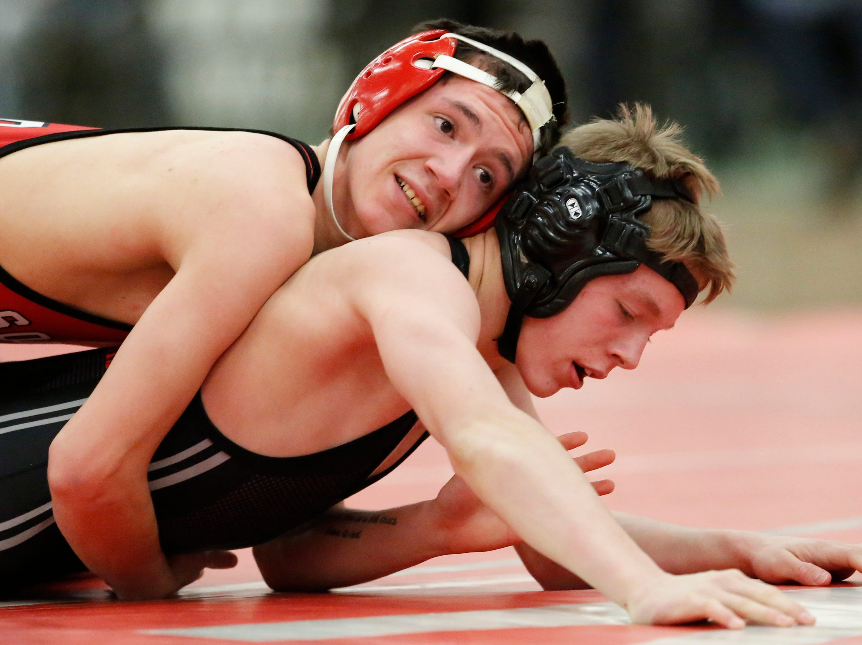 Sheboygan South's Alonzo Backhaus wrestles Plymouth's Kade Novak in the 120 weight class during the WIAA D1 Regionals at Manitowoc Lincoln High School Saturday, February 9, 2019, in Manitowoc, Wis. Joshua Clark/USA TODAY NETWORK-Wisconsin