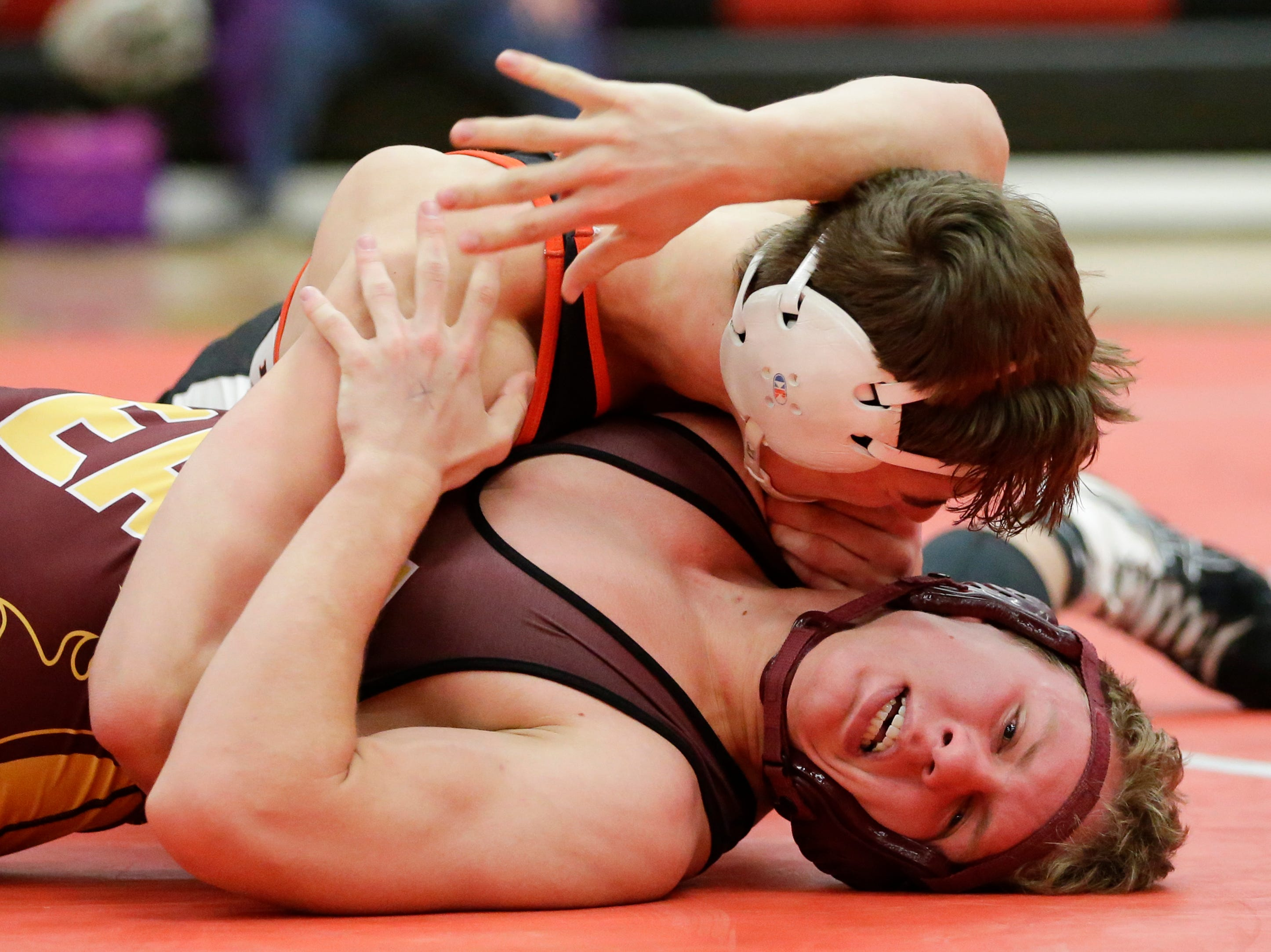 Manitowoc Lincoln's Jacob DeBruin wrestles West Bend East's Brady Schmidt in the 170 weight class during the WIAA D1 Regionals at Manitowoc Lincoln High School Saturday, February 9, 2019, in Manitowoc, Wis. Joshua Clark/USA TODAY NETWORK-Wisconsin
