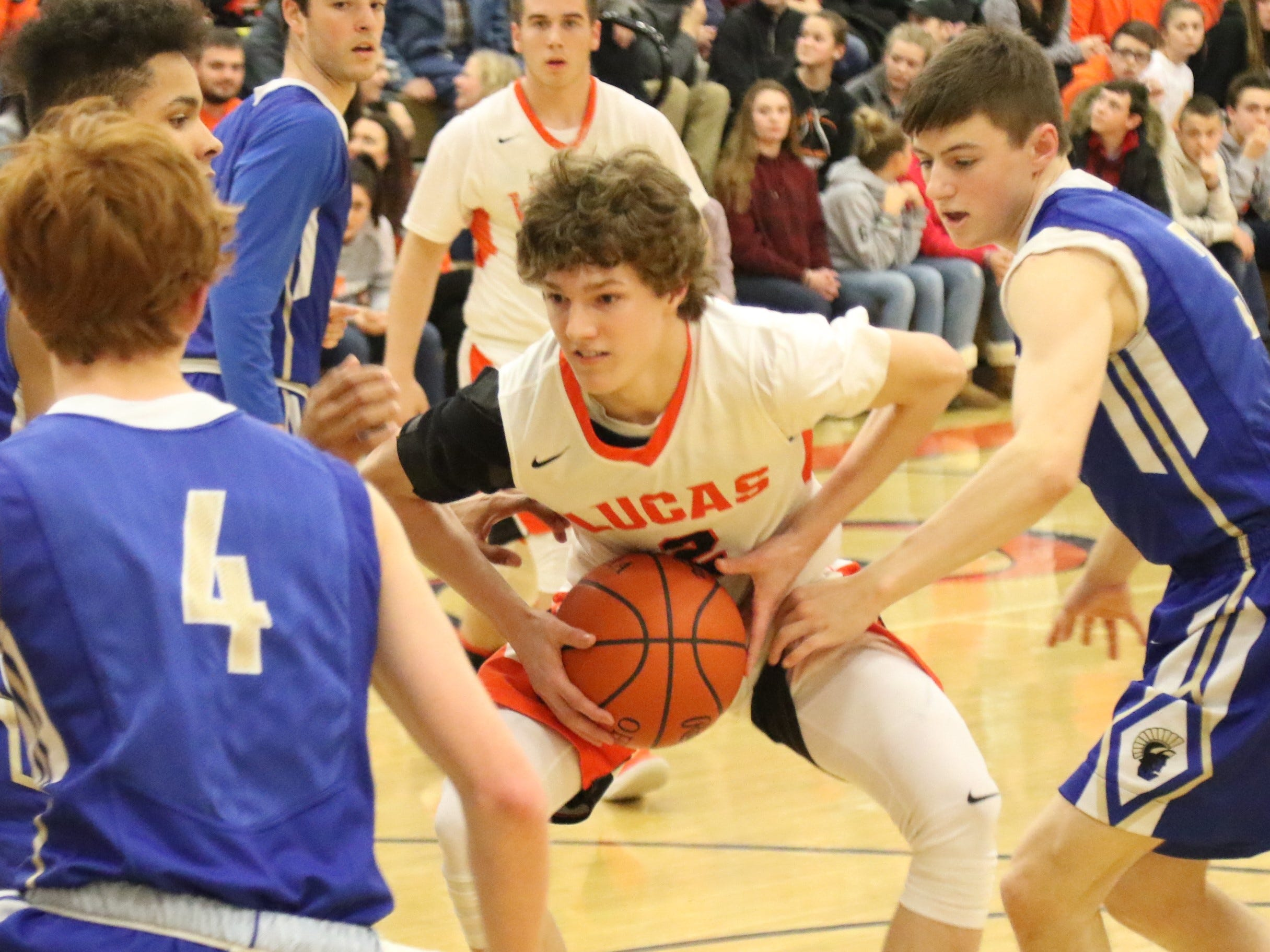 Lucas' Carson Hauger jump stops in the lane during the Cubs' Mid-Buckeye Conference clinching victory on Friday night.