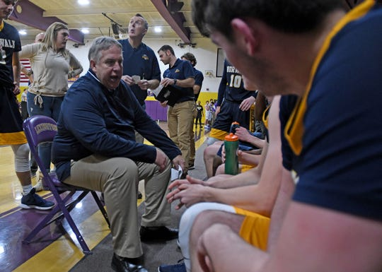 Norwalk basketball coach Steve Gray talks to his team during a timeout in a recent game at Lexington.