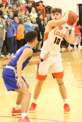 Lucas' Logan Niswander looks for an open teammate during the Cubs' Mid-Buckeye Conference title clinching victory over St. Peter's on Friday.