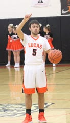 Lucas' Ethan Sauder holds up one finger as he lead the Cubs to a 65-52 victory over St. Peter's to claim the Mid-Buckeye Conference championship on Friday night.