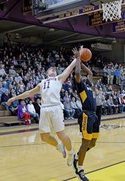 Lexington's Kaydan Berry and Brandon Haraway of Norwalk battle for a rebound Friday night at Lexington High School.