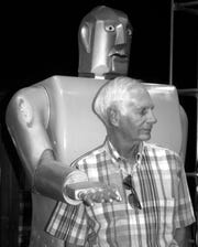 Frank Ruth is reunited with Elektro in 2004 at the Mansfield Memorial Museum.