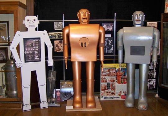 From left, Herbert Televox, a replica of Elektro and Elektro himself standing inside the Mansfield Memorial Museum.