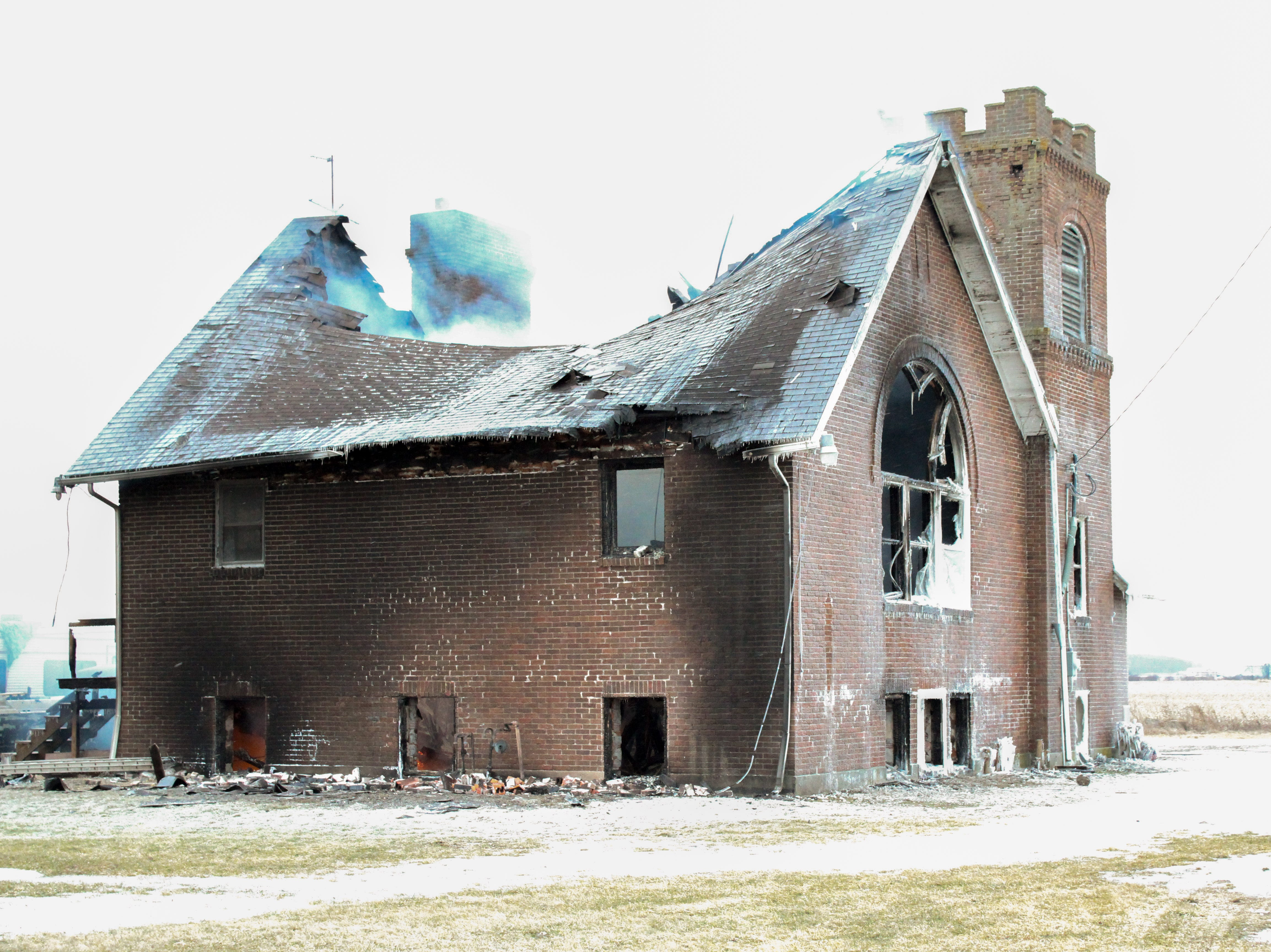 A Friday evening blaze claimed an old church on Likens Road. The fire continued to burn in the basement Saturday morning.