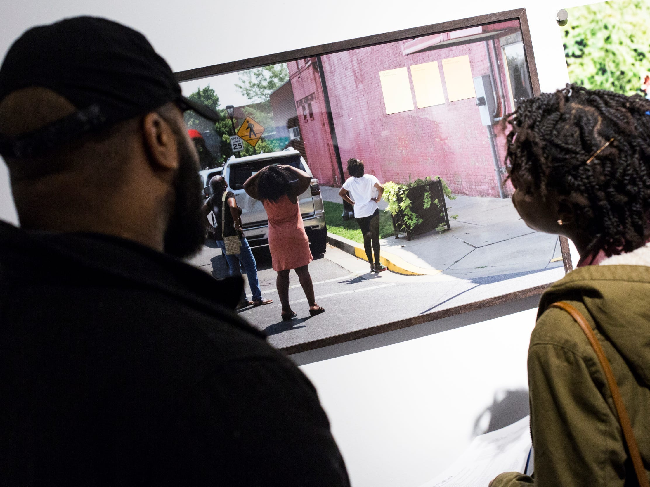 February 08, 2019 - Alandria Ivory, right, and Michael Wright, left, look at work during the PHTGRPHS show featuring work by Lester Merriweather and Lawrence Matthews at The CMPLX. The CMPLX, a gallery, office and work space for The Collective, is located at 2234 Lamar Ave. in the Lamar Airways Shopping Center in Orange Mound.