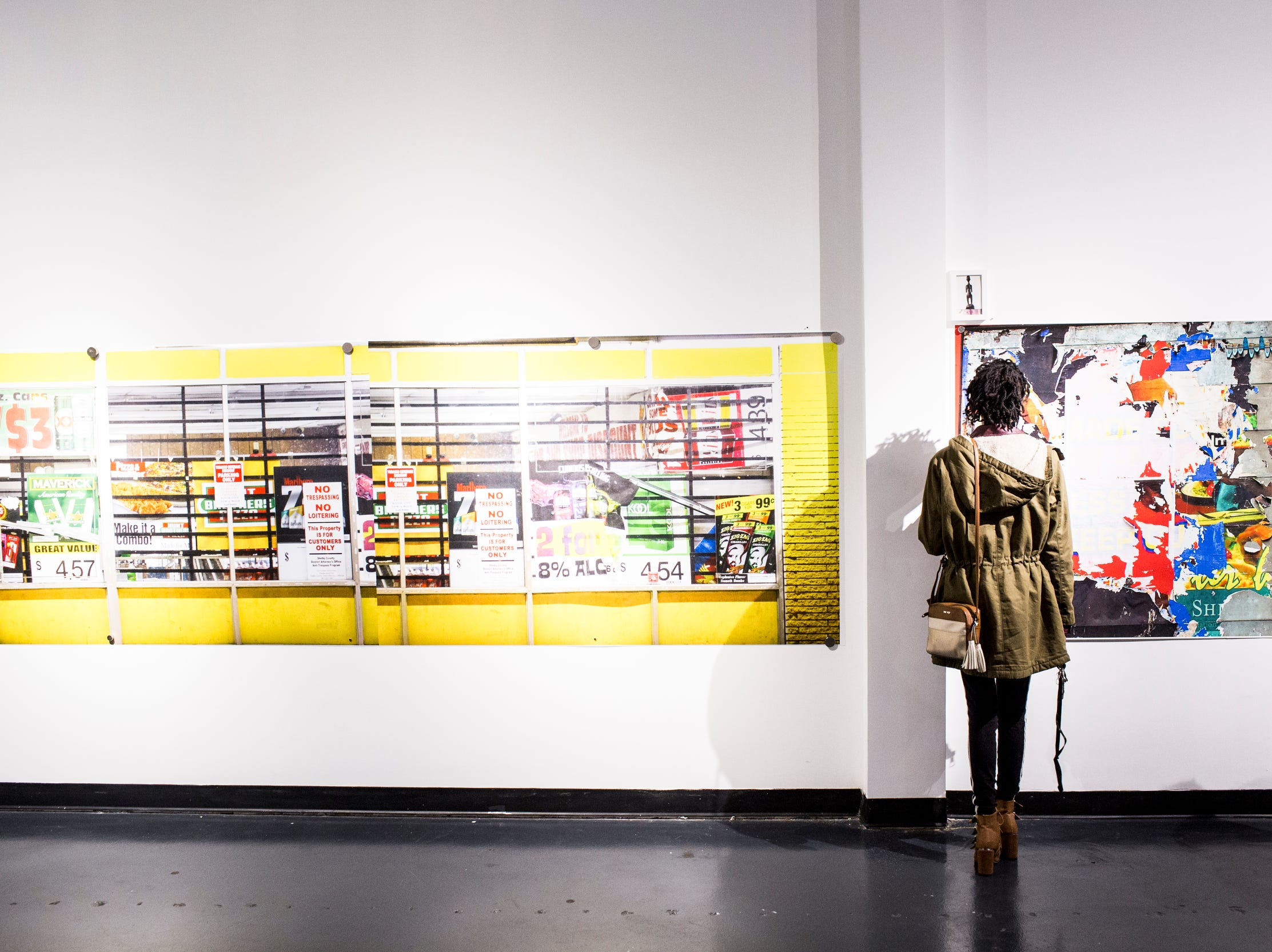 February 08, 2019 - Alandria Ivory looks at work during the PHTGRPHS show featuring work by Lester Merriweather and Lawrence Matthews at The CMPLX. The CMPLX, a gallery, office and work space for The Collective, is located at 2234 Lamar Ave. in the Lamar Airways Shopping Center in Orange Mound.