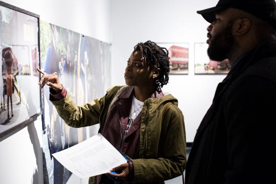 February 08, 2019 - Alandria Ivory, left, and Michael Wright, right, look at work during the PHTGRPHS show featuring work by Lester Merriweather and Lawrence Matthews at The CMPLX. The CMPLX, a gallery, office and work space for The Collective, is located at 2234 Lamar Ave. in the Lamar Airways Shopping Center in Orange Mound.