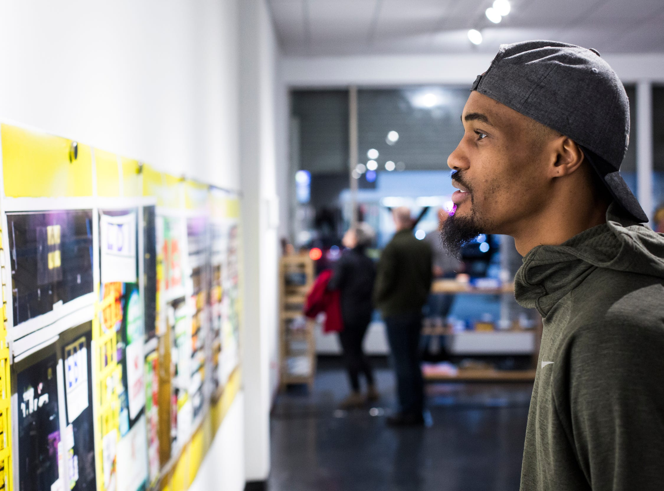 February 08, 2019 - Kerrier Tappin looks at work during the PHTGRPHS show featuring work by Lester Merriweather and Lawrence Matthews at The CMPLX. The CMPLX, a gallery, office and work space for The Collective, is located at 2234 Lamar Ave. in the Lamar Airways Shopping Center in Orange Mound.