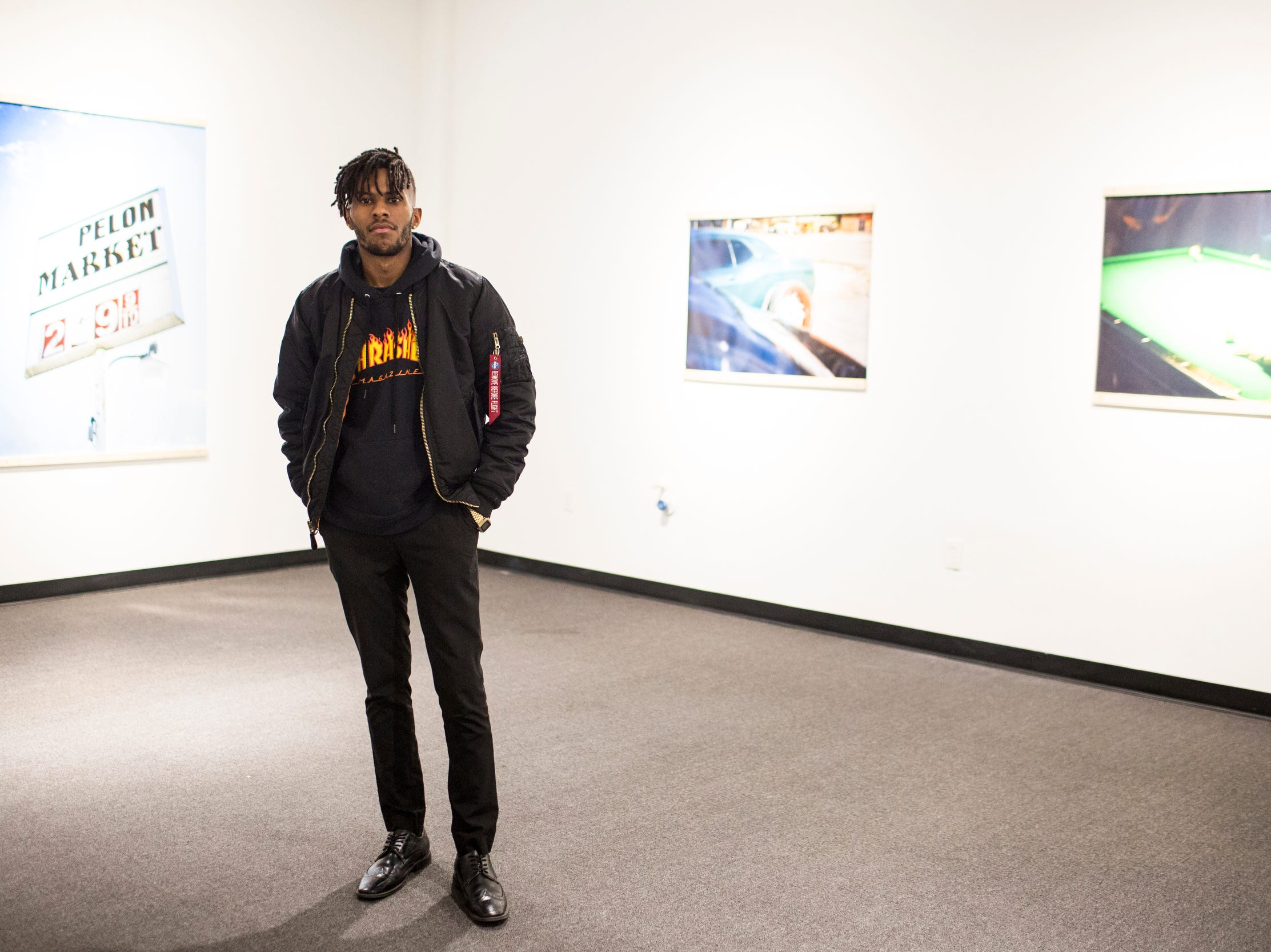 February 08, 2019 - Lawrence Matthews poses in front of some of his work during the PHTGRPHS show featuring work by Matthews and Lester Merriweather at The CMPLX. The CMPLX, a gallery, office and work space for The Collective, is located at 2234 Lamar Ave. in the Lamar Airways Shopping Center in Orange Mound.