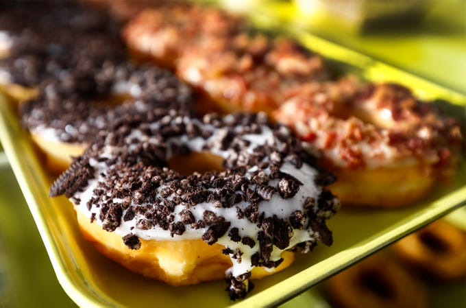 Freshly made Oreo and bacon maple during the grand opening of Midtown Donut on Union Ave., Saturday morning. Midtown Donuts will offer a selection of coffees, including brewed coffee and cappuccinos. The doughnut shop will be open seven days a week from 4 a.m. to 7 p.m.