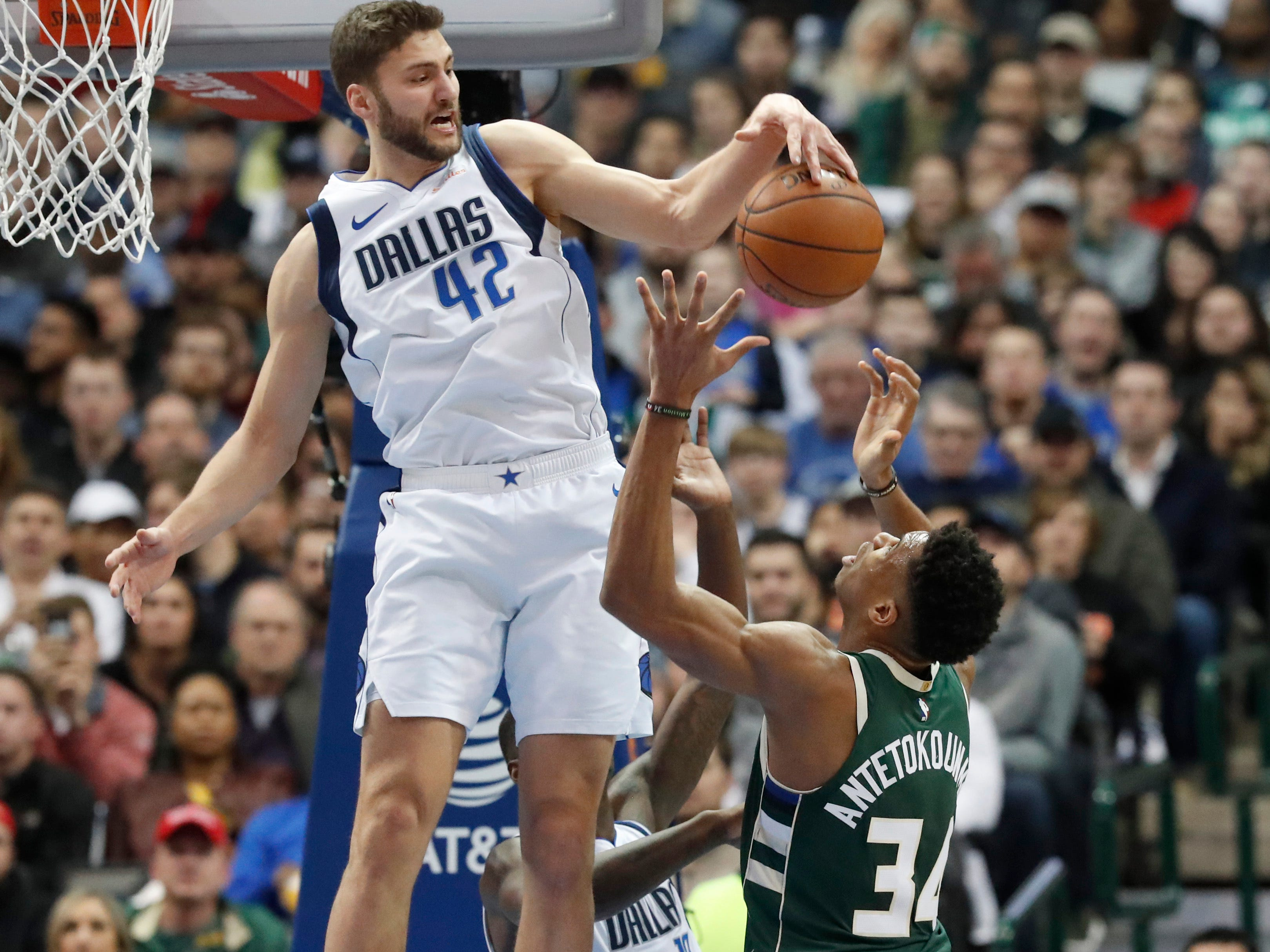 Mavericks forward Maxi Kleber stuffs a shot by Bucks forward Giannis Antetokounmpo during the first half of Friday night.