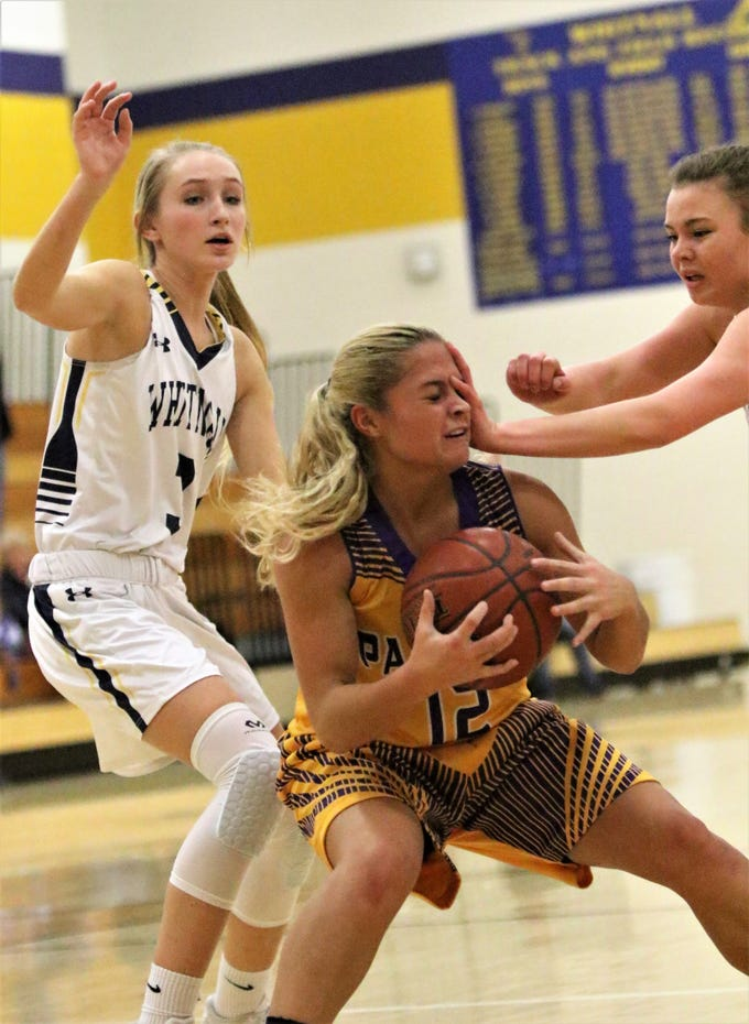 Cudahy guard Camryn Kratt gets hit in the face by a Whitnall defender during a   game on Feb. 8, 2019.