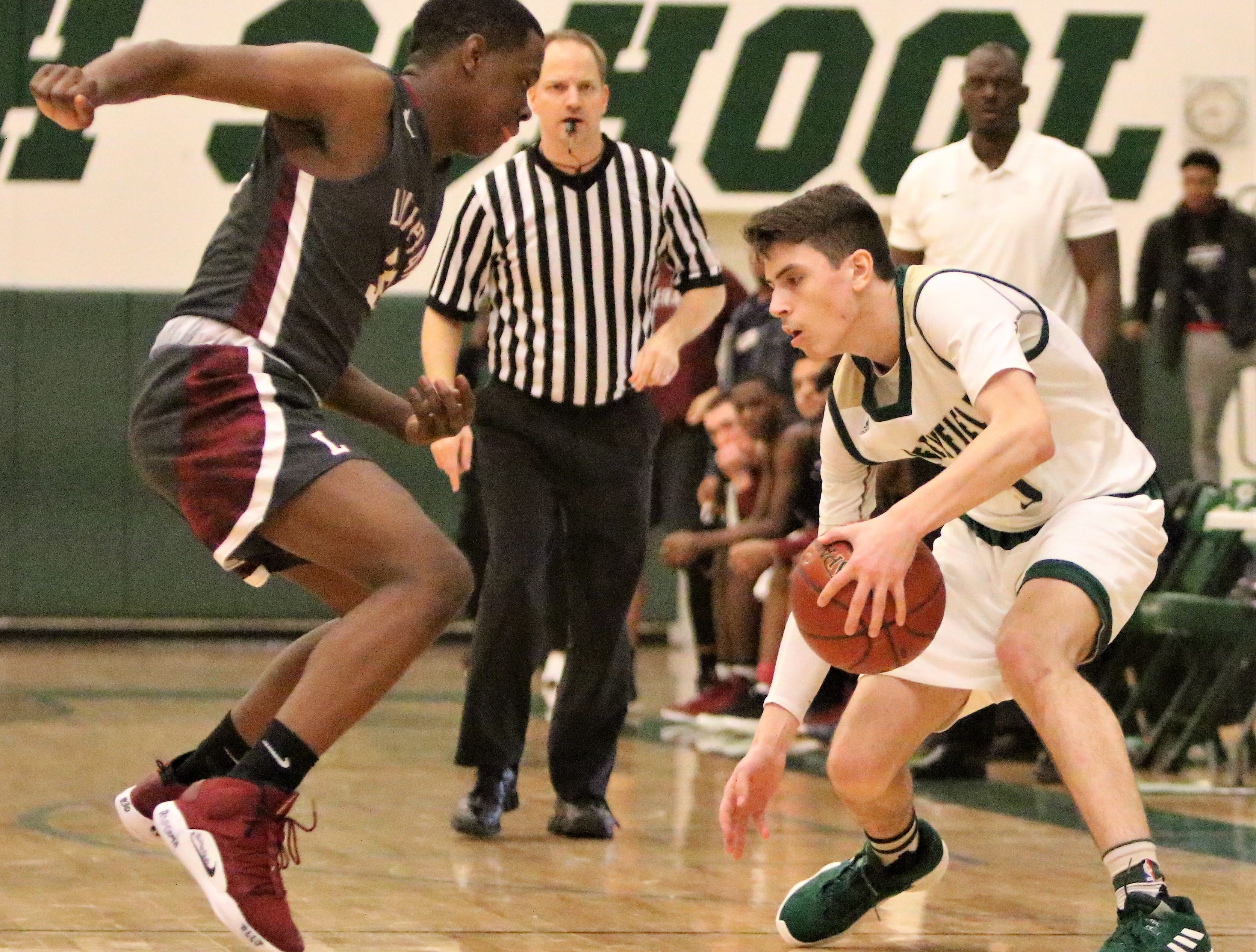 Greenfield guard Chris Lopez pulls back his dribble against Milwaukee Lutheran on Feb. 8, 2019.