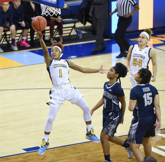 Marquette guard Danielle King beats Georgetown guards Dionna White and Mikayla Venson as she goes up for a layup on Friday night. King scored 12 points, as did teammates Amani Wilborn and Isabelle Spingola, to lead the Golden Eagles.