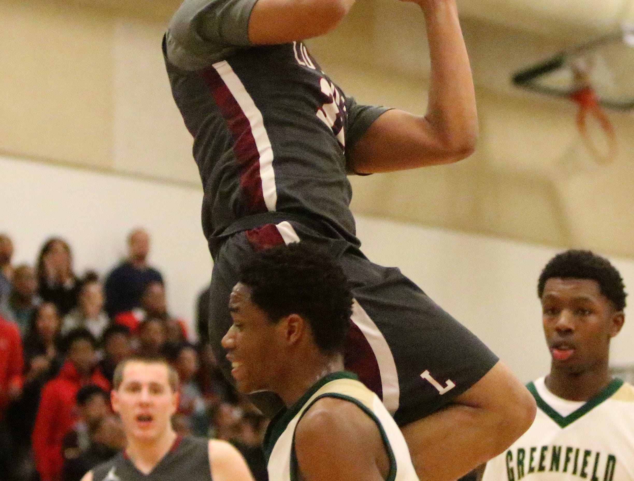 Milwaukee Lutheran forward Jourdan Weddle rises up for a layup against Greenfield on Feb. 8, 2019.
