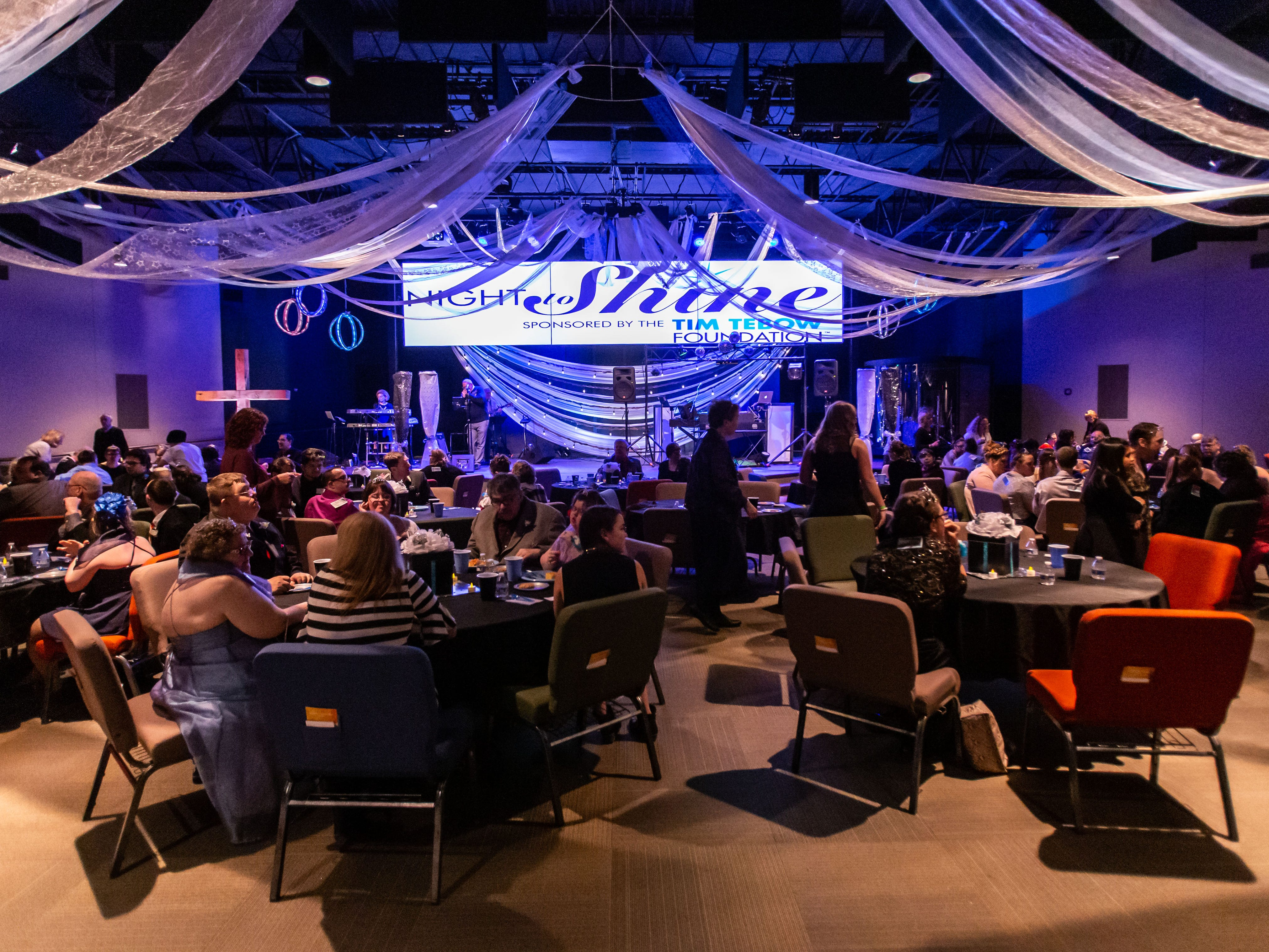 Guests enjoy a catered dinner and live music during the Night to Shine Prom hosted by Brooklife Church in Mukwonago on Friday, Feb. 8, 2019. Night to Shine is a unforgettable prom night experience for people with special needs sponsored by the Tim Tebow Foundation. The event is hosted by local churches in all 50 states across the globe all on one night.