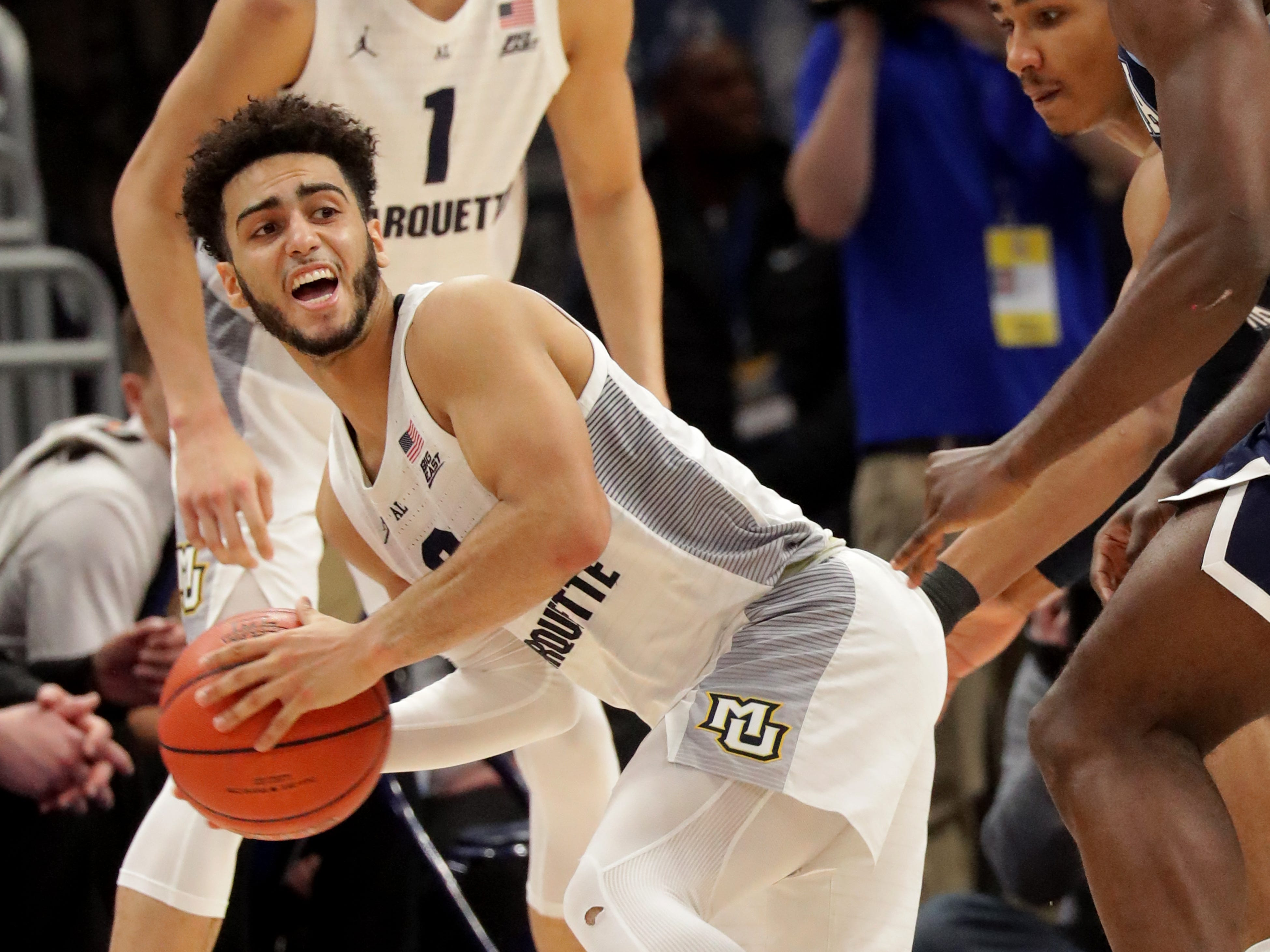 Marquette  guard Markus Howard looks to pass out of traffic on Saturday.