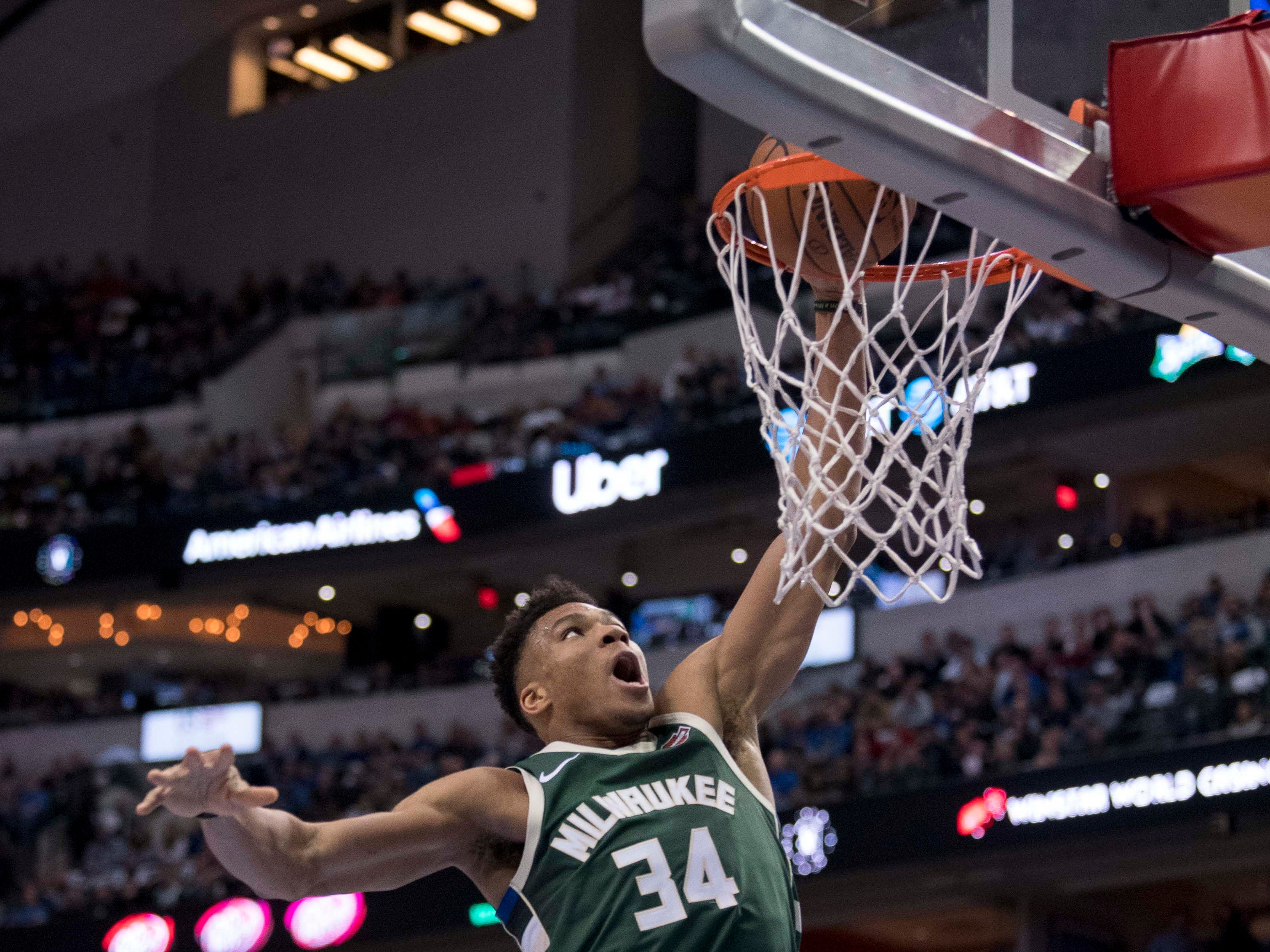 Bucks forward Giannis Antetokounmpo hammers down one of the many dunks he had Friday night against the Mavericks.