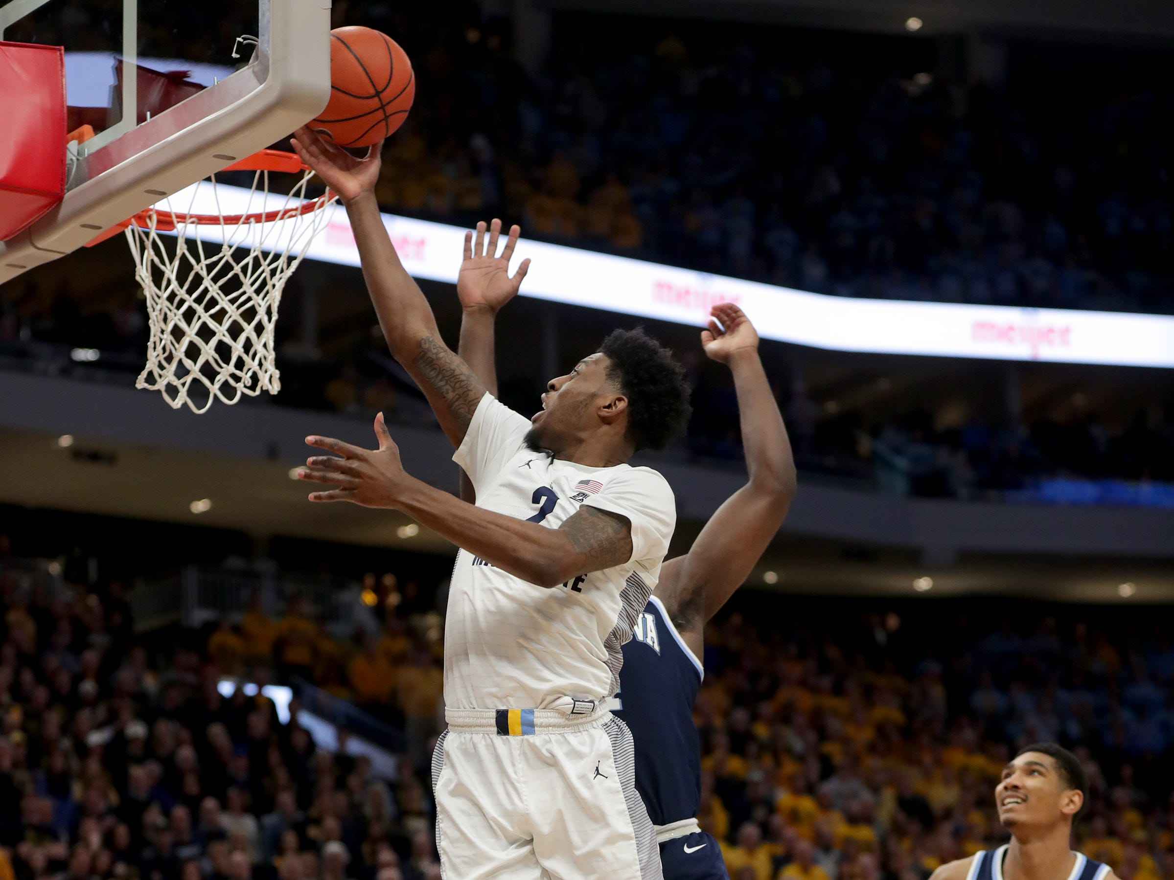 Marquette  forward Sacar Anim gets to the rim and past Villanova forward Eric Paschall on Saturday.