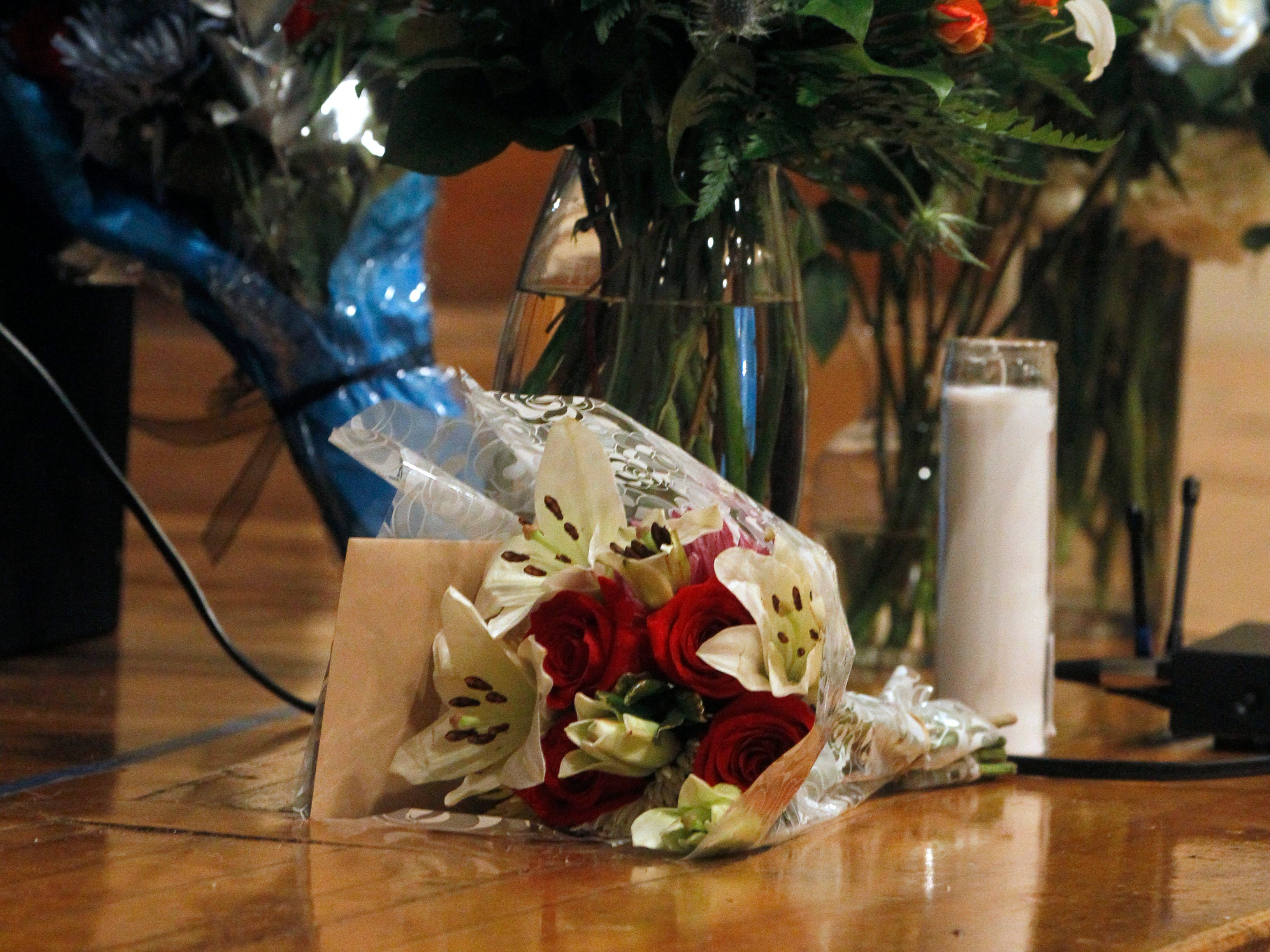 Flowers line the stage in honor of fallen Milwaukee Police Officer Matthew Rittner.