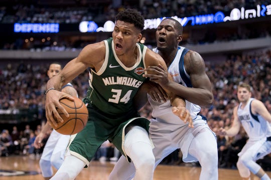 Bucks forward Giannis Antetokounmpo drives against Mavericks forward Dorian Finney-Smith during the second quarter Friday night in Dallas.