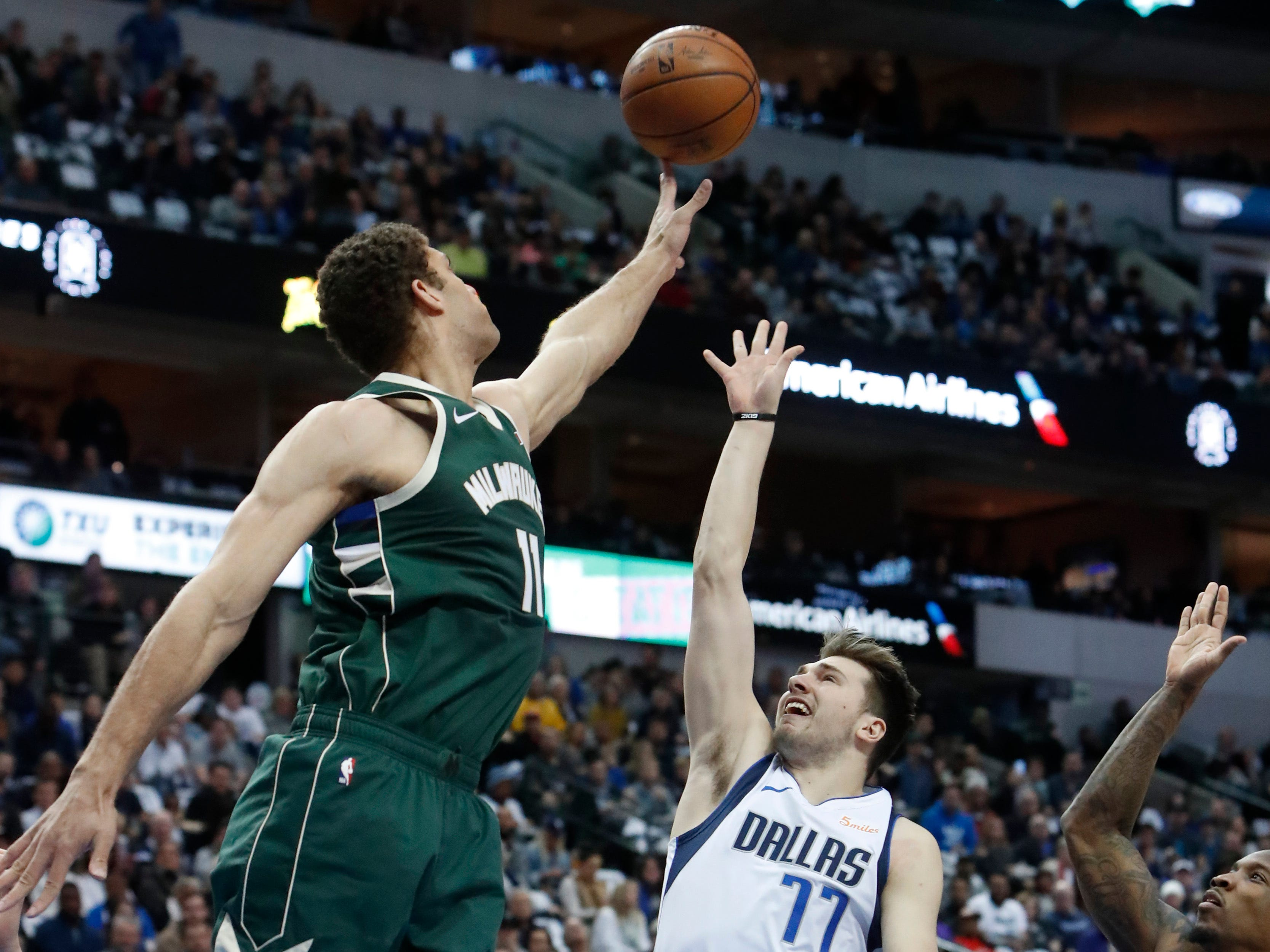 Bucks center Brook Lopez blocks a shot by Mavericks forward Luka Doncic  during the second half Friday night.