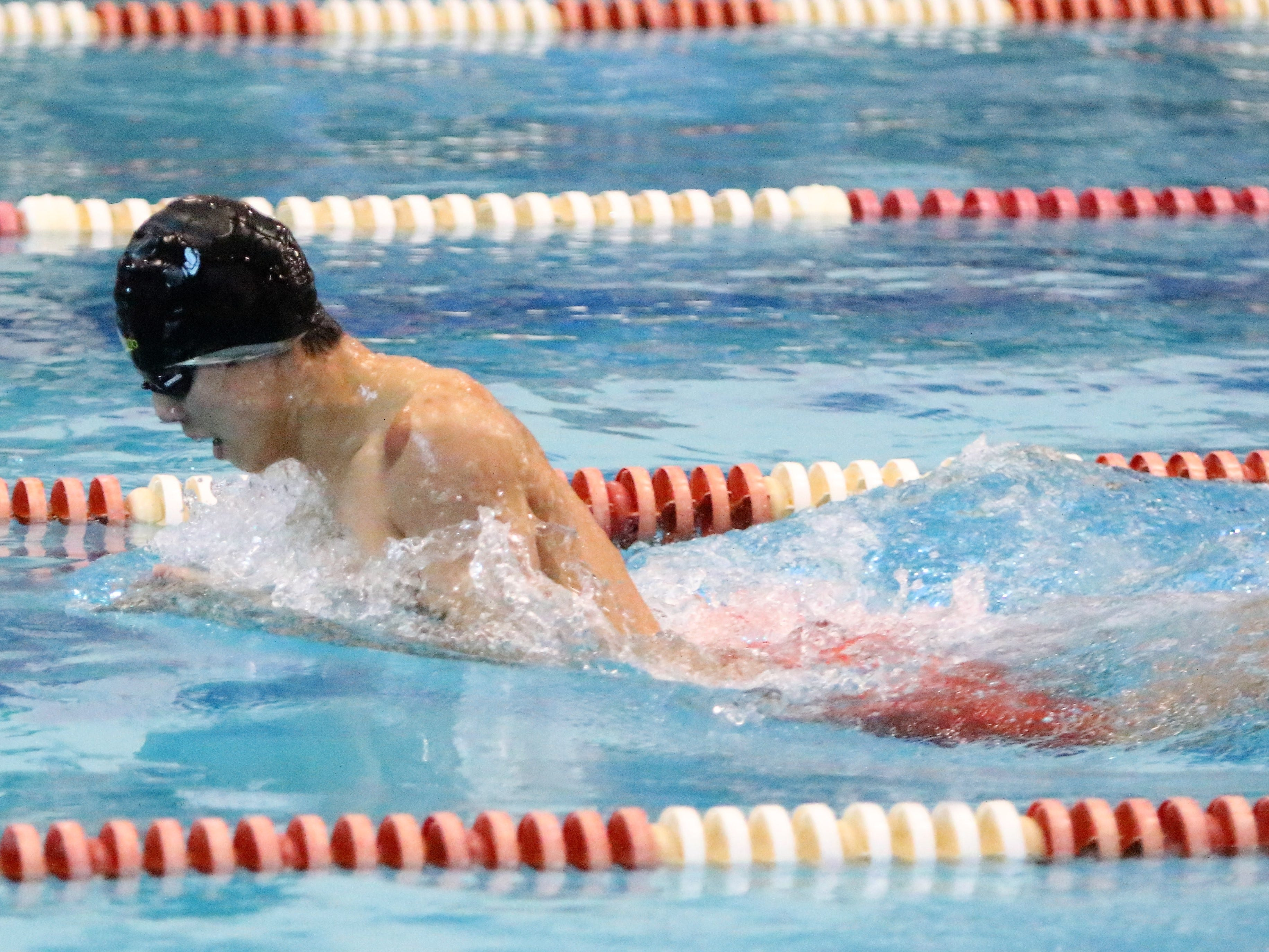 Menomonee Falls co-op junior Josh Wu swims to victory in the 100 yard breaststroke at the WIAA sectional meet  at Homestead High School on Feb. 9, 2019.