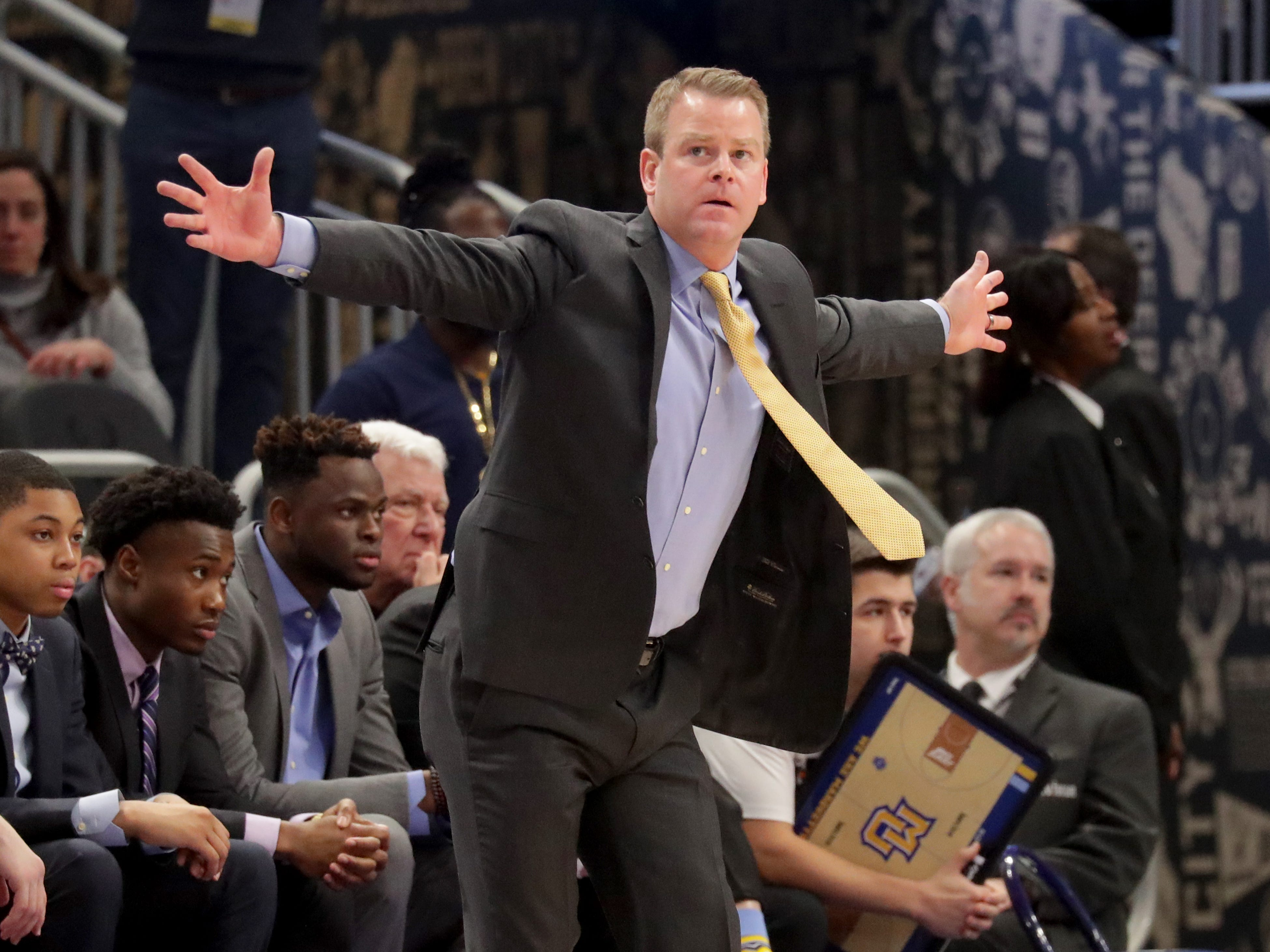 Marquette Golden Eagles head coach Steve Wojciechowski calls in a play in the first half on Saturday.