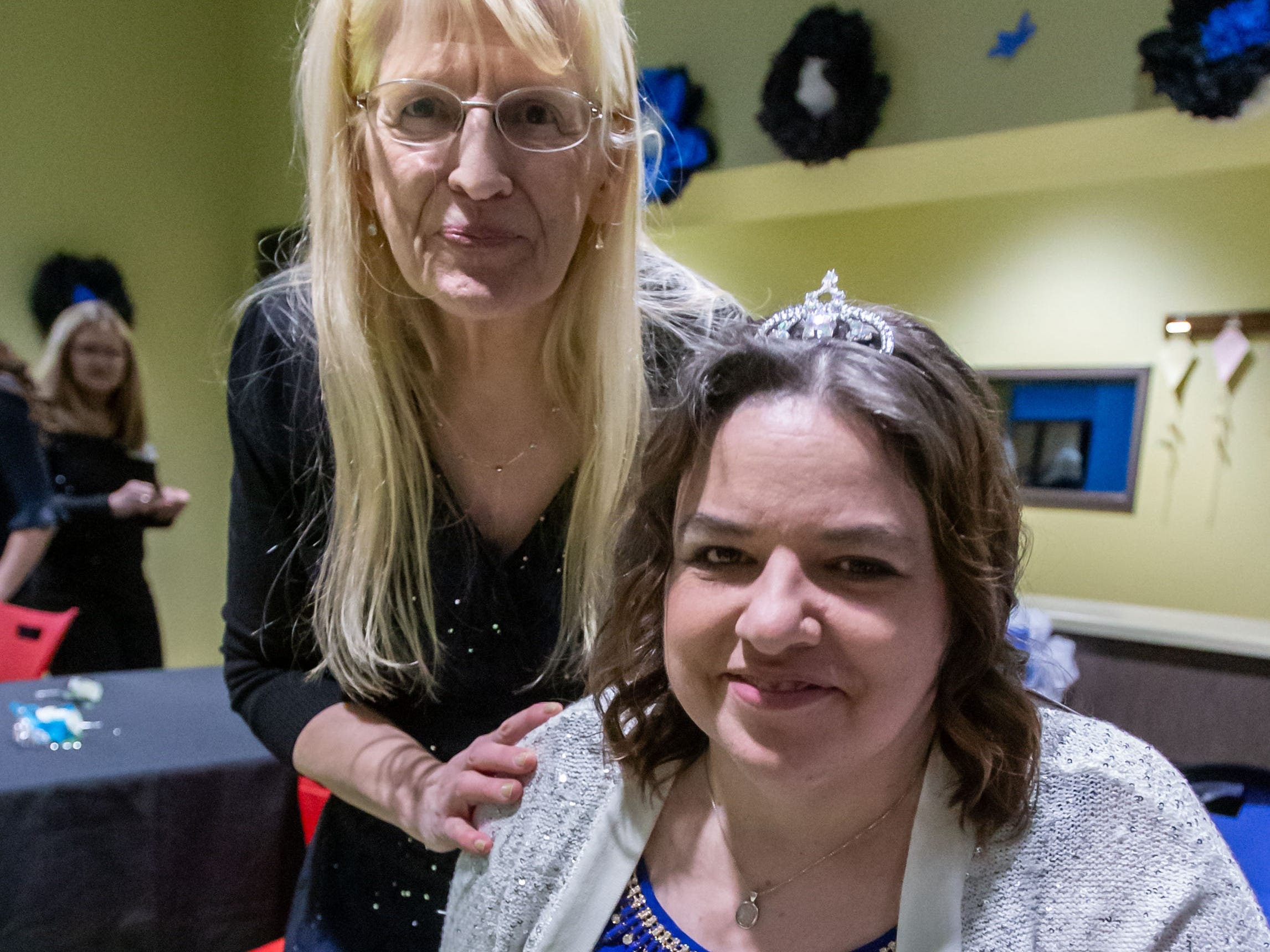 Brooke H. is fitted with her prom queen crown by volunteer Genevieve Sartler during the Night to Shine Prom hosted by Brooklife Church in Mukwonago on Friday, Feb. 8, 2019. Every guest of Night to Shine receives the royal treatment, including hair and makeup, limousine rides, corsages and boutonnieres, a catered dinner, karaoke and dancing, all leading up to the moment when each guest is crowned king or queen of the prom.