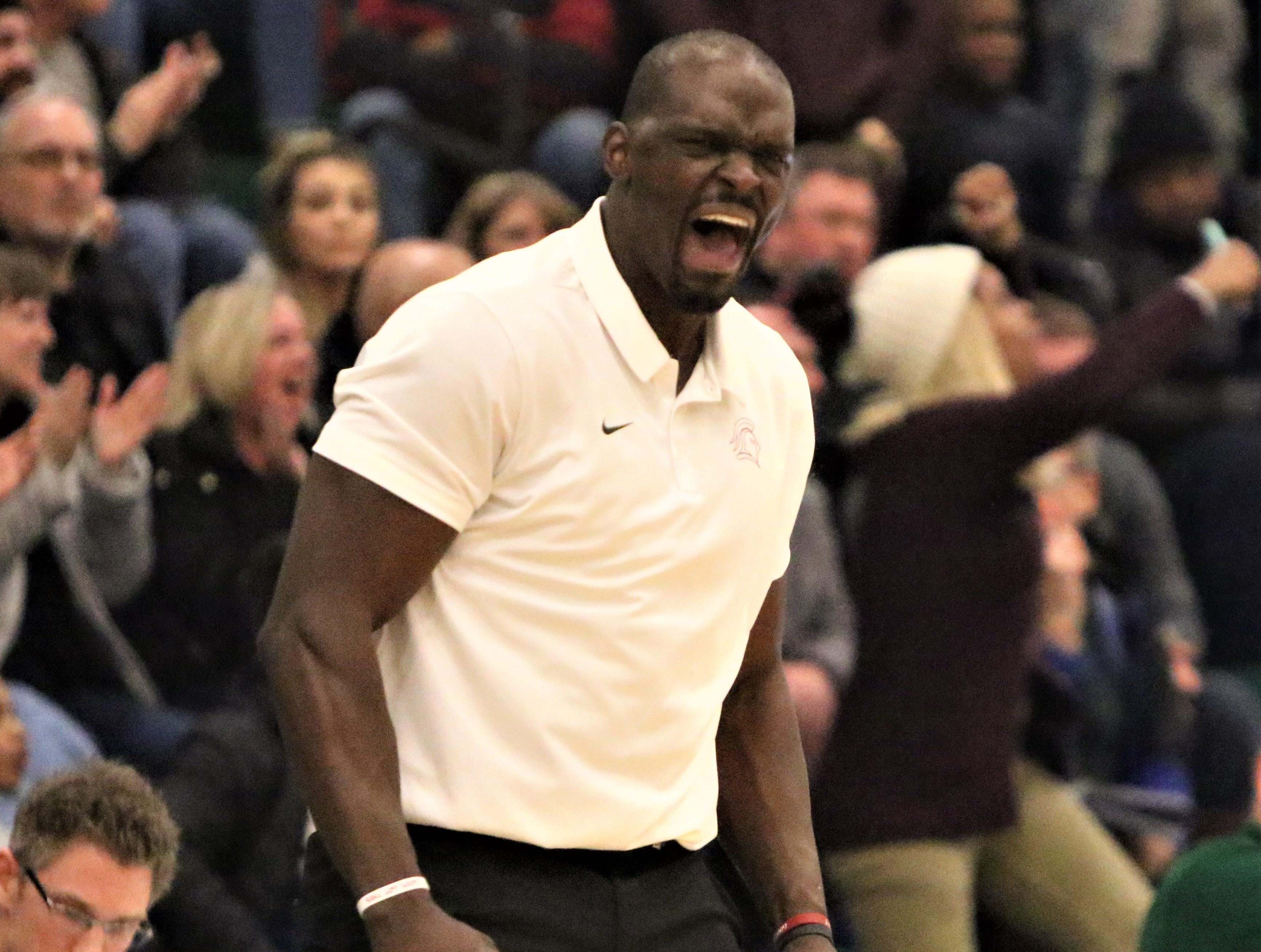 Milwaukee Lutheran head coach Marcus Jackson celebrates a basket by his team during a game against Greenfield on Feb. 8, 2019.