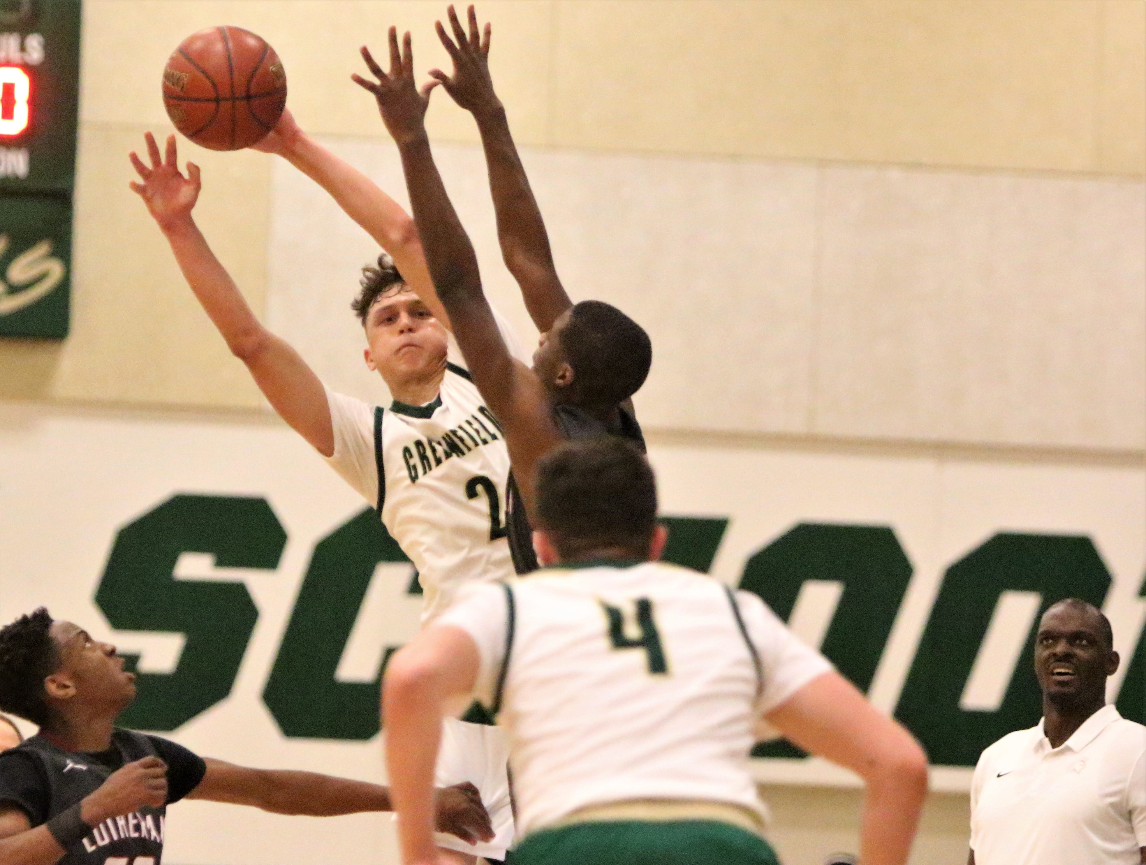 Greenfield guard Elijah Rosario gets a pass off to a teammate over the Milwaukee Lutheran defense on Feb. 8, 2019.