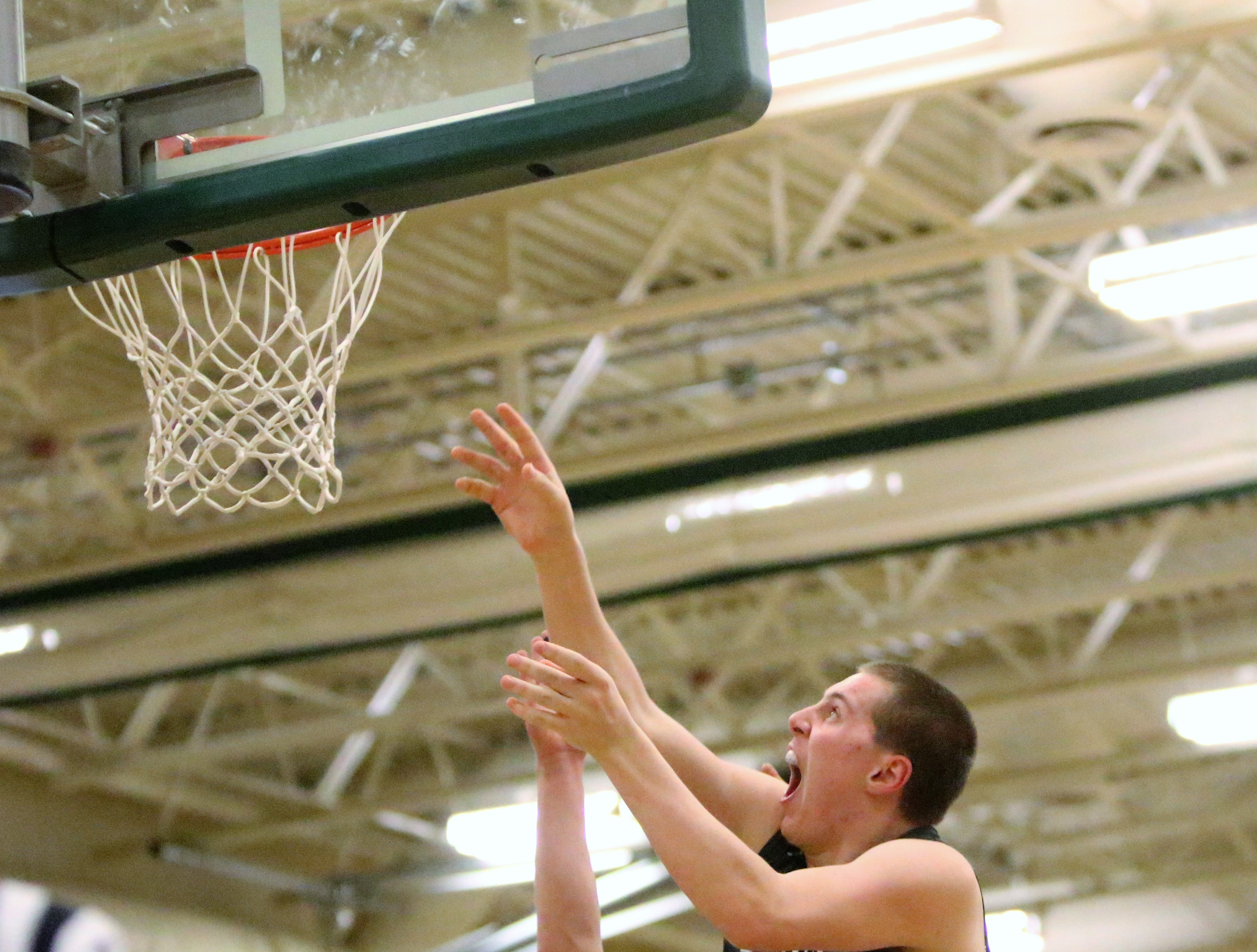 Milwaukee Lutheran forward Danny Perdzock watches his layup bounce off the glass for two points against Greenfield on Feb. 8, 2019.