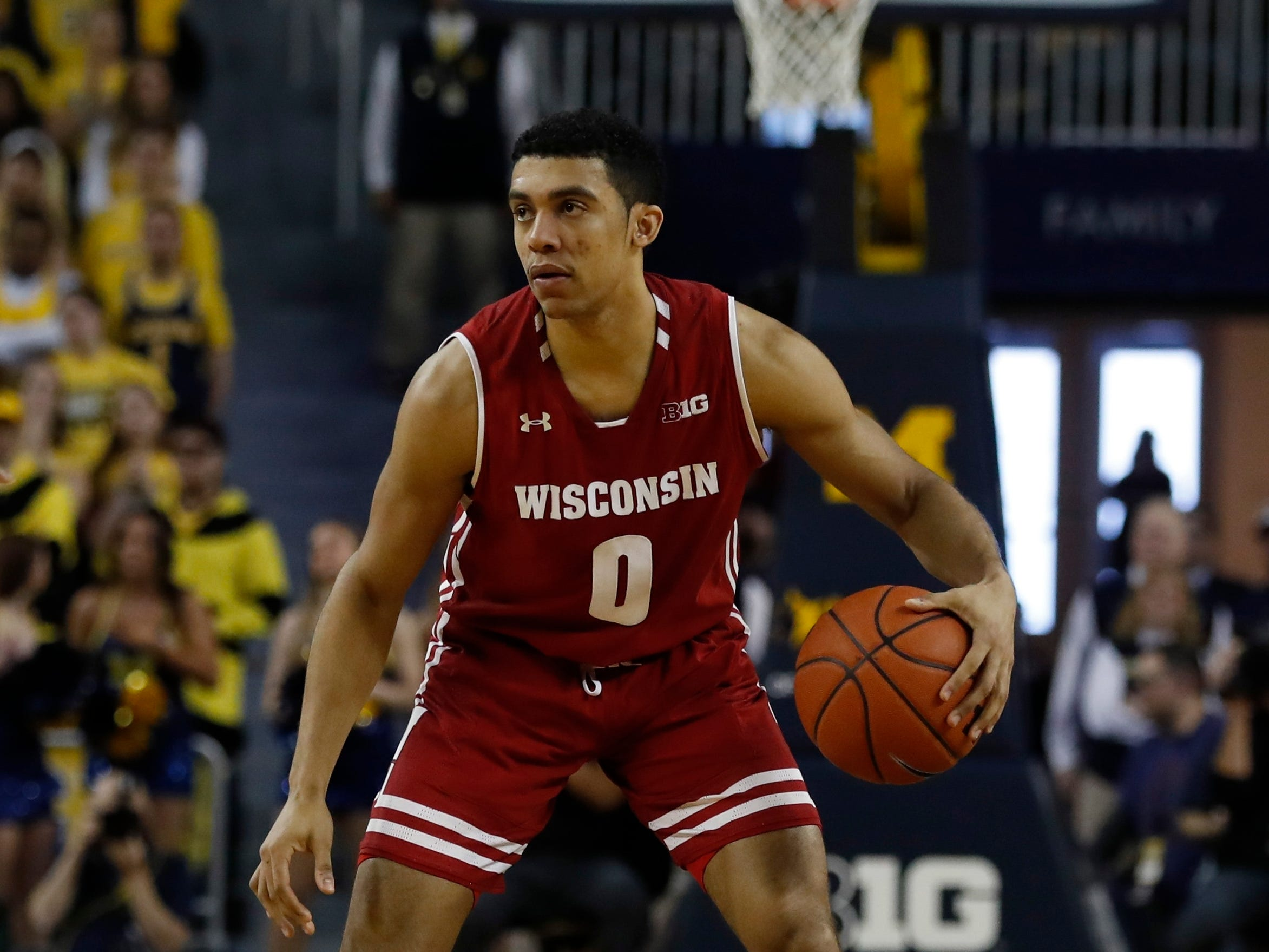 Wisconsin guard D'Mitrik Trice looks for an open man on Saturday.