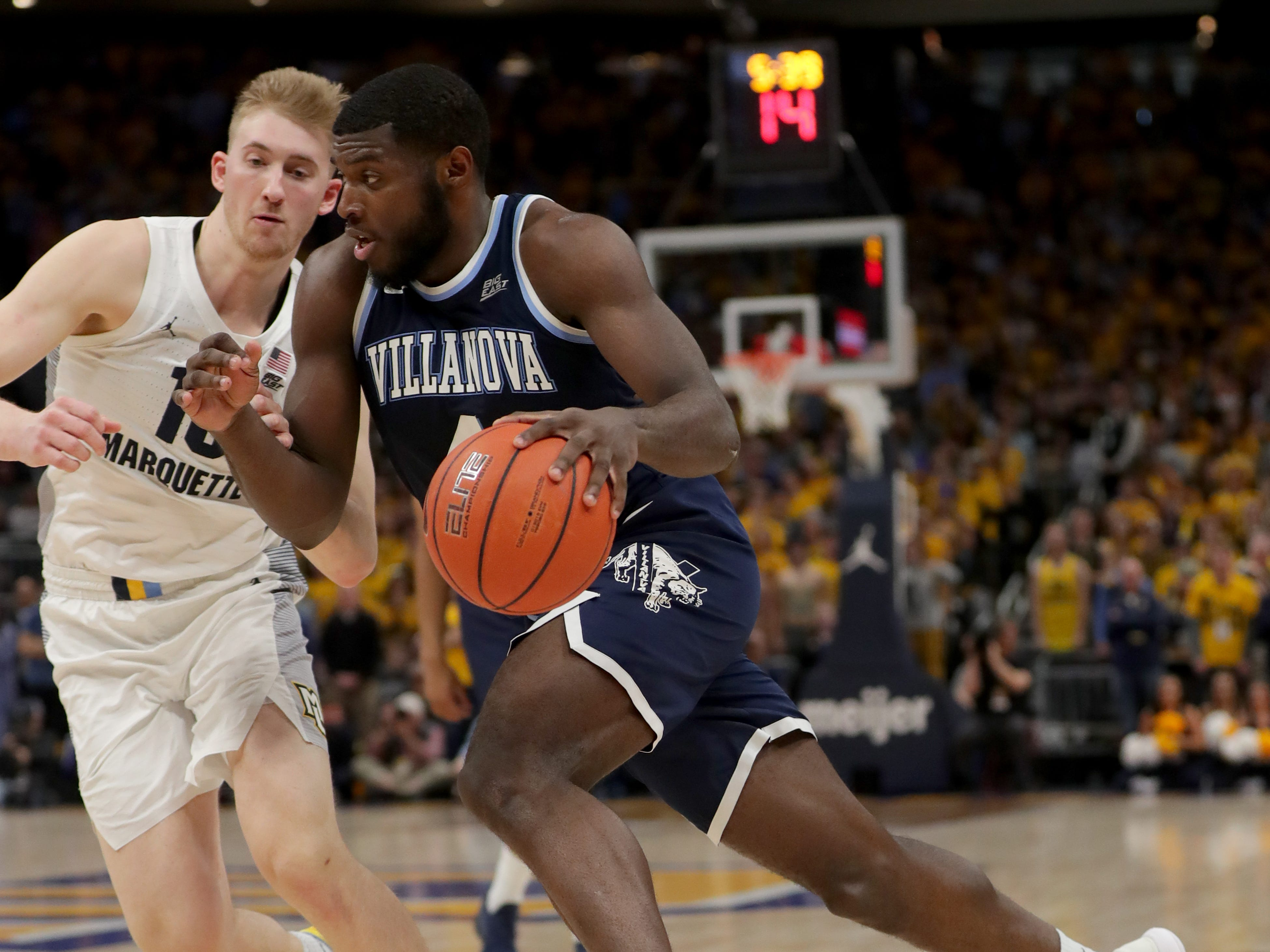 Villanova Wildcats forward Eric Paschall  drives to the basket past Marquette's Sam Hauser.