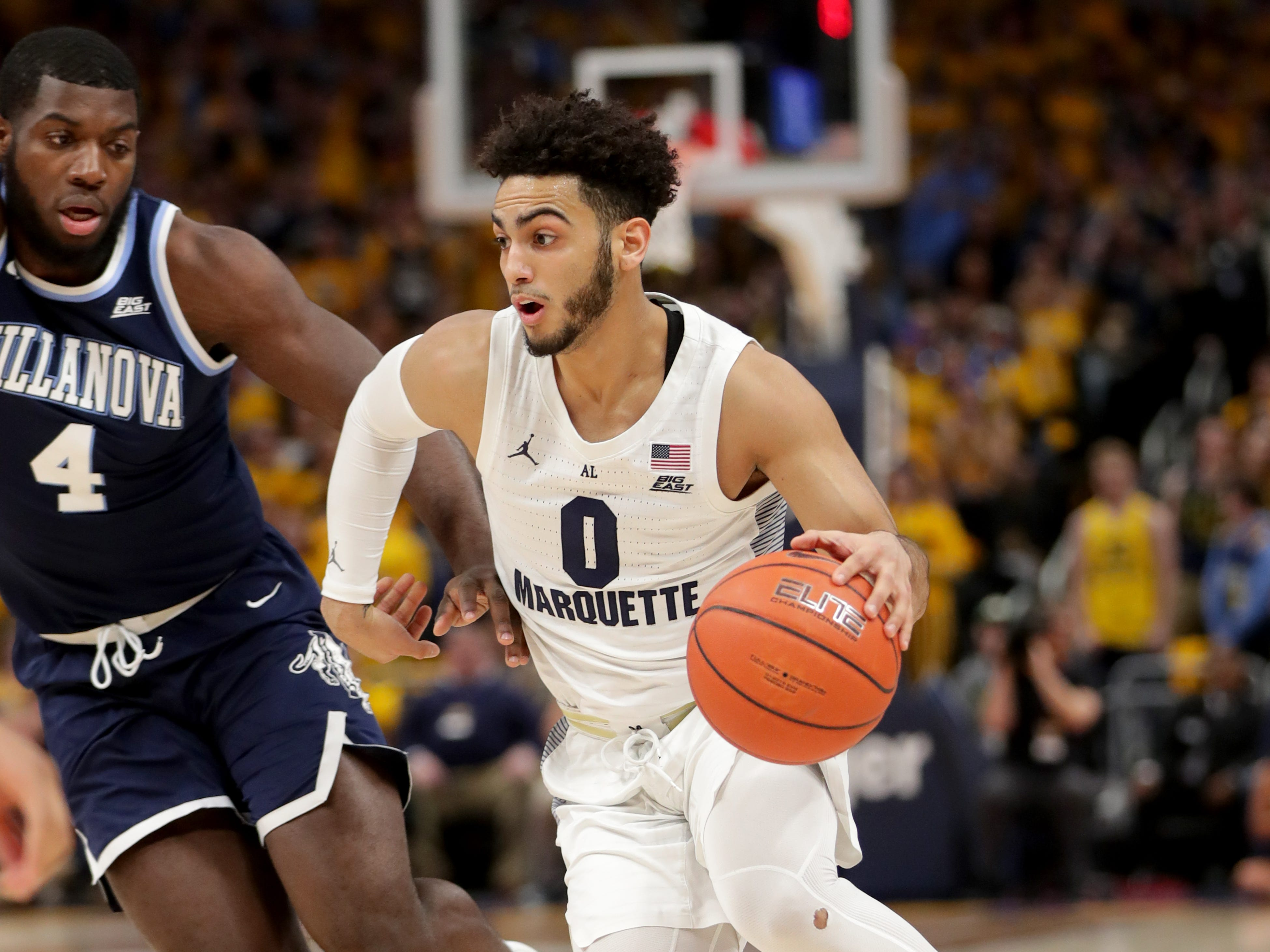 Marquette  guard Markus Howard drives to the basket past Villanova  forward Eric Paschall.