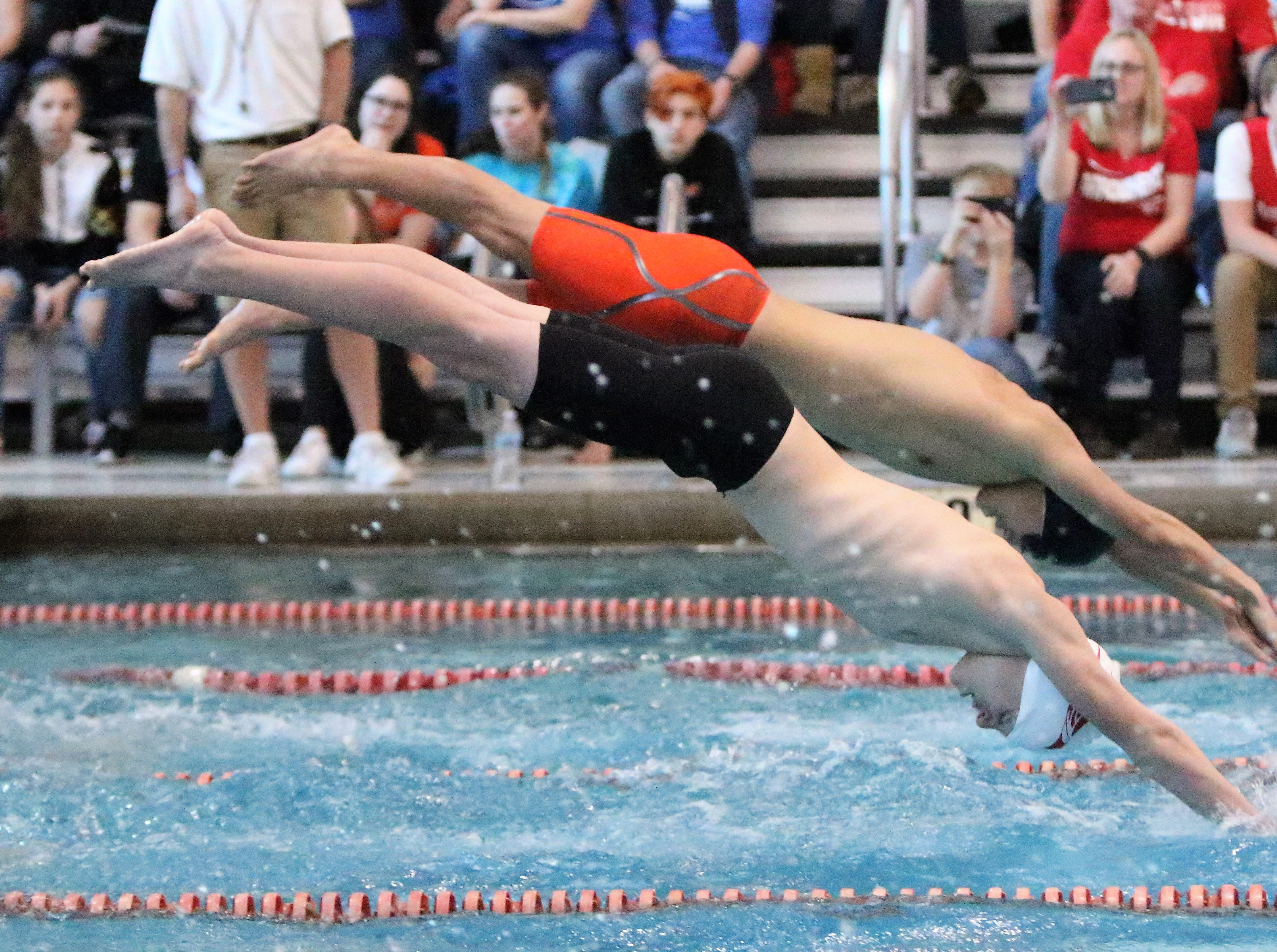Arrowhead's Aiden Jacobsen and Menomonee Falls' Josh Wu dive into the water at the WIAA sectional meet at Homestead High School on Feb. 9, 2019.