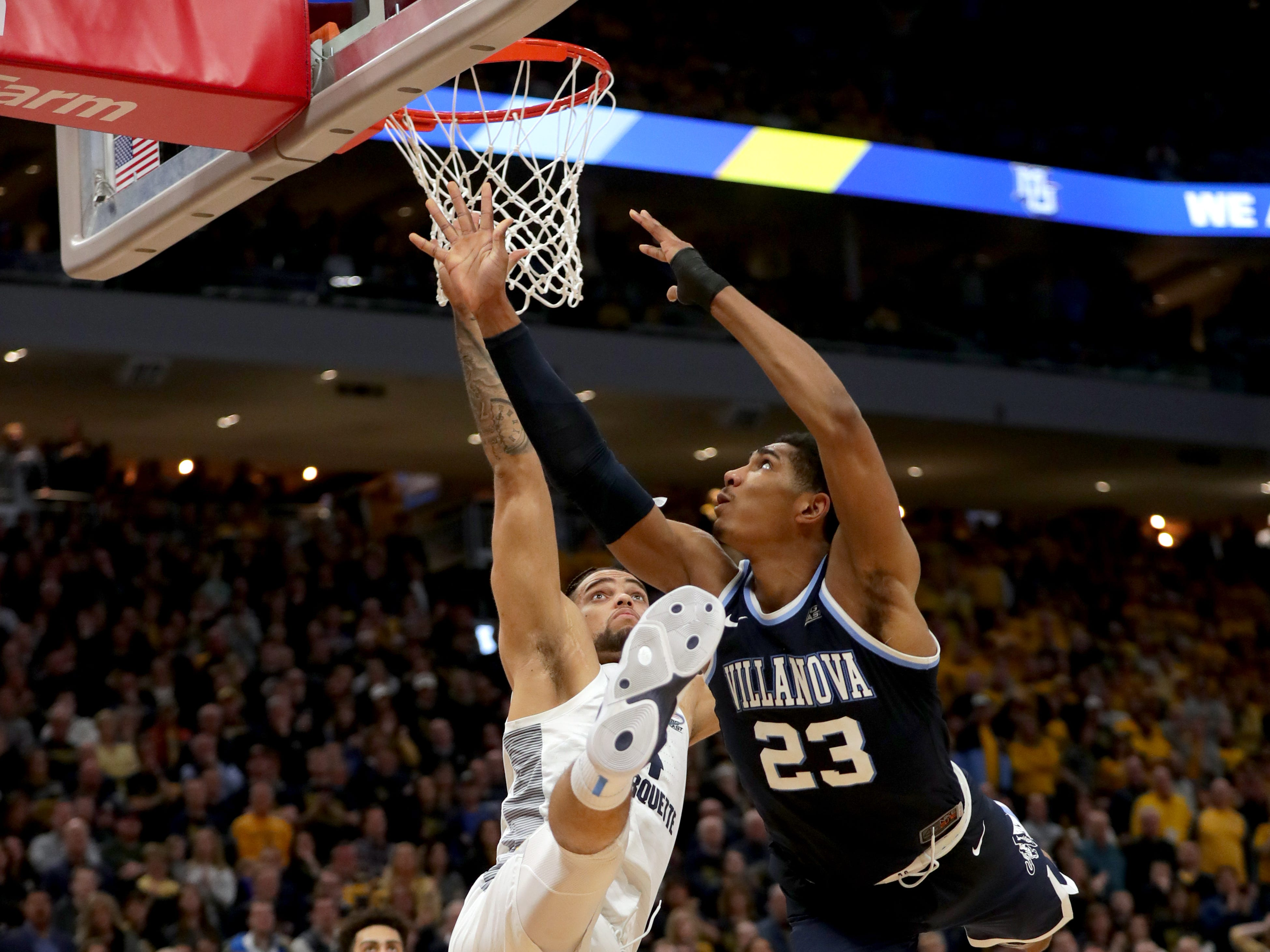 Villanova forward Jermaine Samuels is fouled by Marquette's Theo John on Saturday.