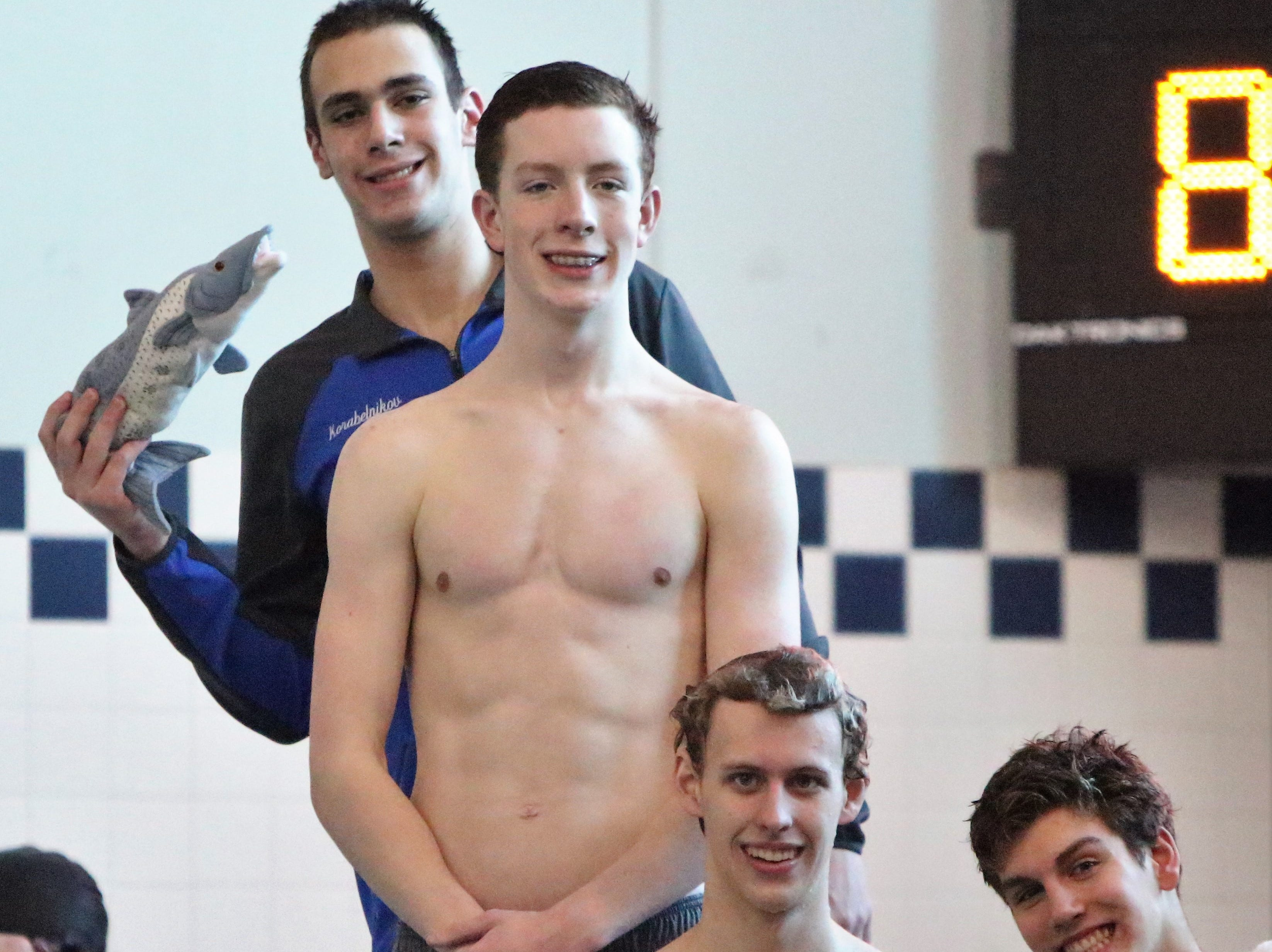 The Brookfield 200 yard freestyle relay of Brian Daniels, AJ Smith, Ido Korabelnikov and Michael Linnihan stand atop the diving platform after a first place finish at the WIAA sectional at Homestead High School on Feb. 9, 2019.