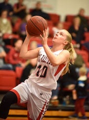 Norfork's Macy Dillard goes up for two during a recent home game. The Lady Panthers completed their second straight unbeaten home season Friday night.