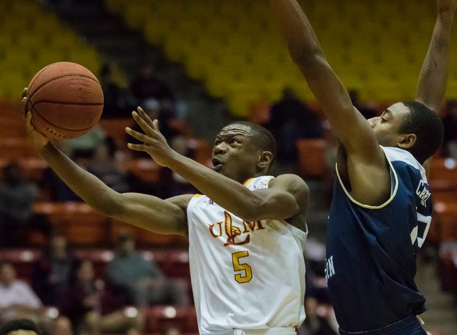 University of Louisiana at Monroe's Daishon Smith (5) extends the ball out to score a lay-up against Georgia Southern's defending Simeon Carter (23) during the game against Georgia Southern at Fant-Ewing Coliseum in Monroe, La. on Feb. 8.