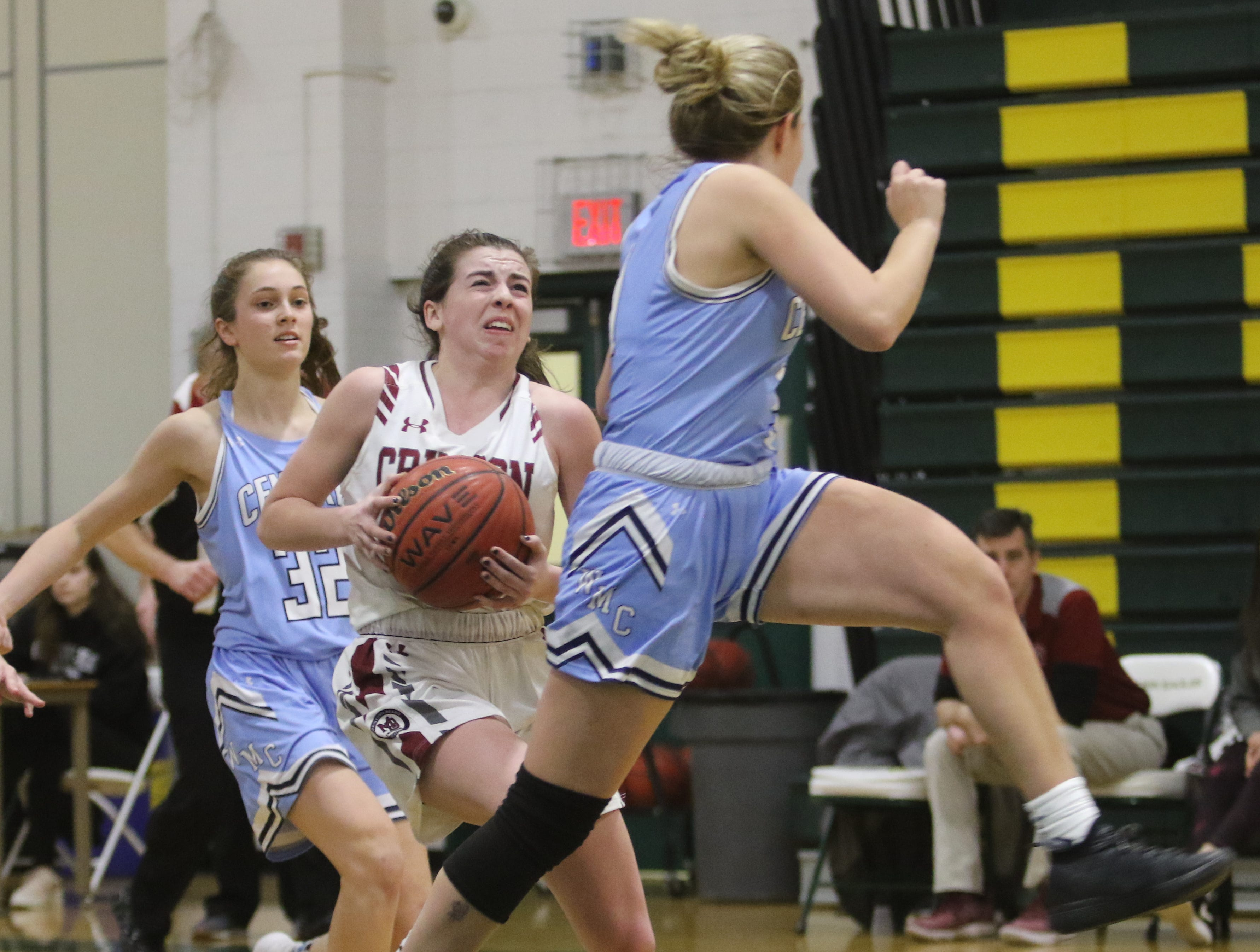 Bridget Monaghan of Morristown-Beard goes to the basket as Mackenzie Selvaggi of West Morris flies by her in the second half.