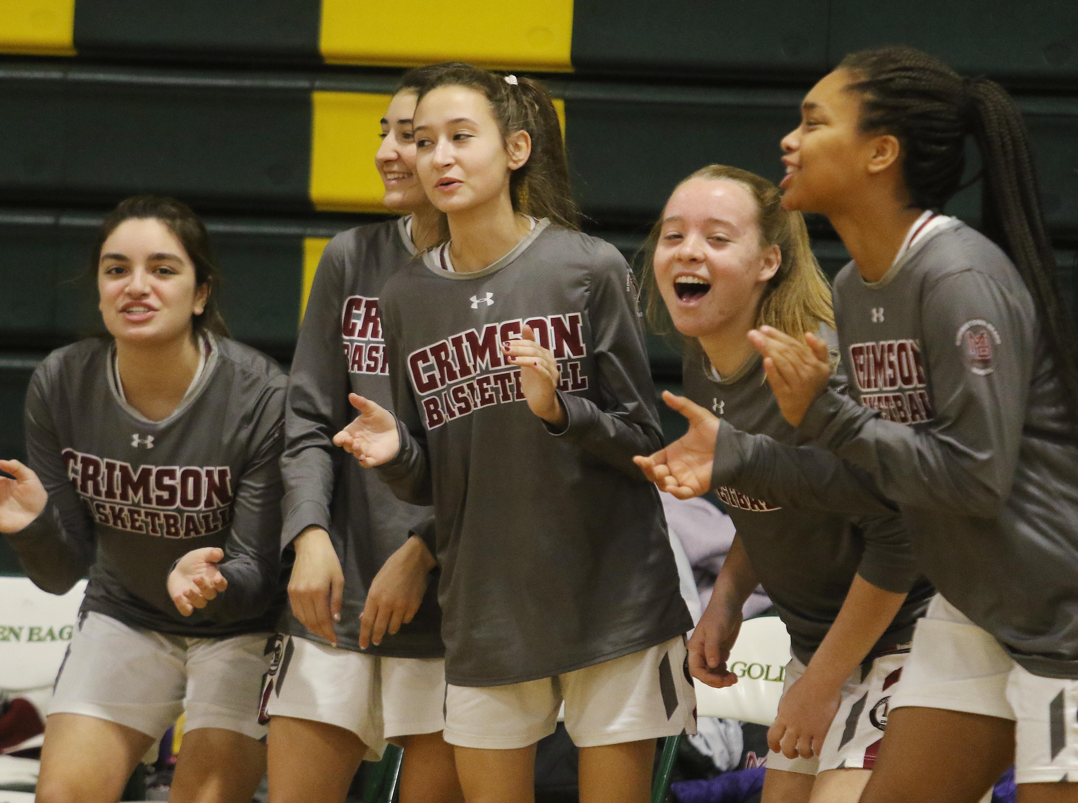 The Morristown-Beard bench cheers on their team late in the game.