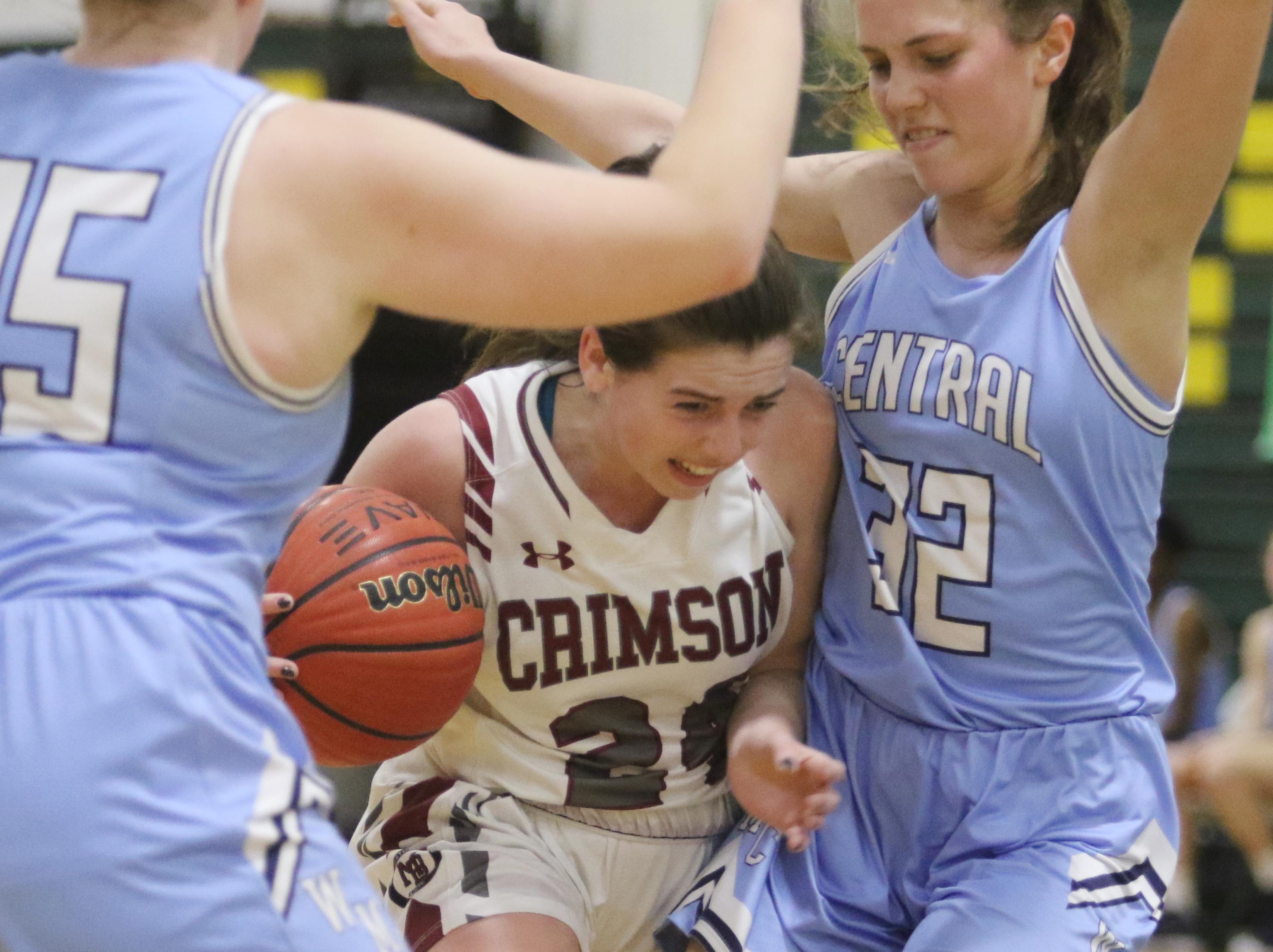 Morristown-Beard senior Bridget Monaghan tries to break through the defense of Olivia Schlok and Elizabeth Mancini of West Morris late in the game.