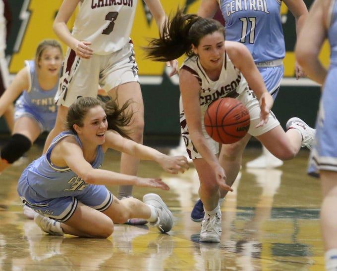 Morristown-Beard senior Bridget Monaghan steals the ball from West Morris junior Elizabeth Mancini in the fourth quarter of a Morris County Tournament girls basketball quarterfinal.