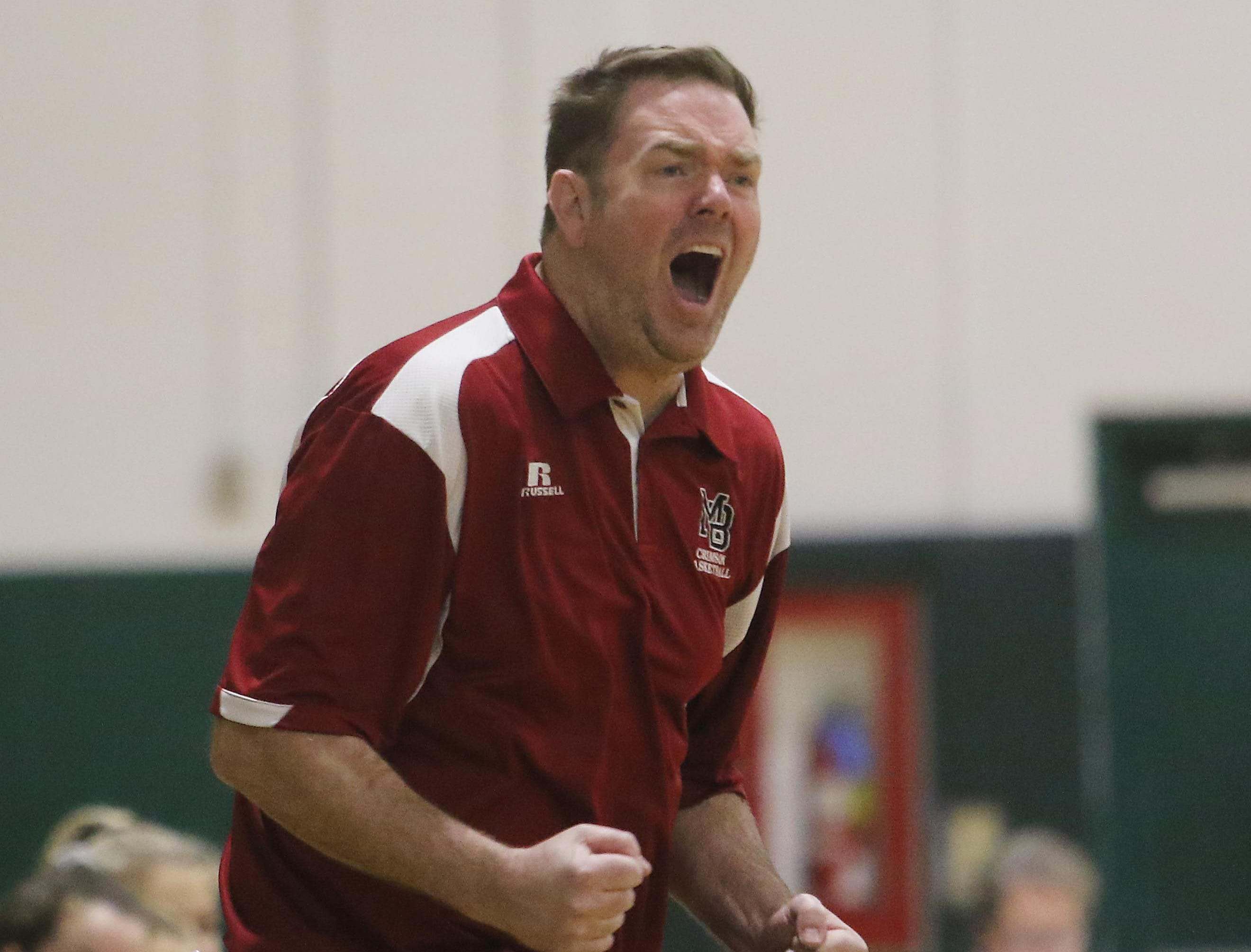 Morristown-Beard coach Mike Sturgeon yells out instructions to his team in the first half.